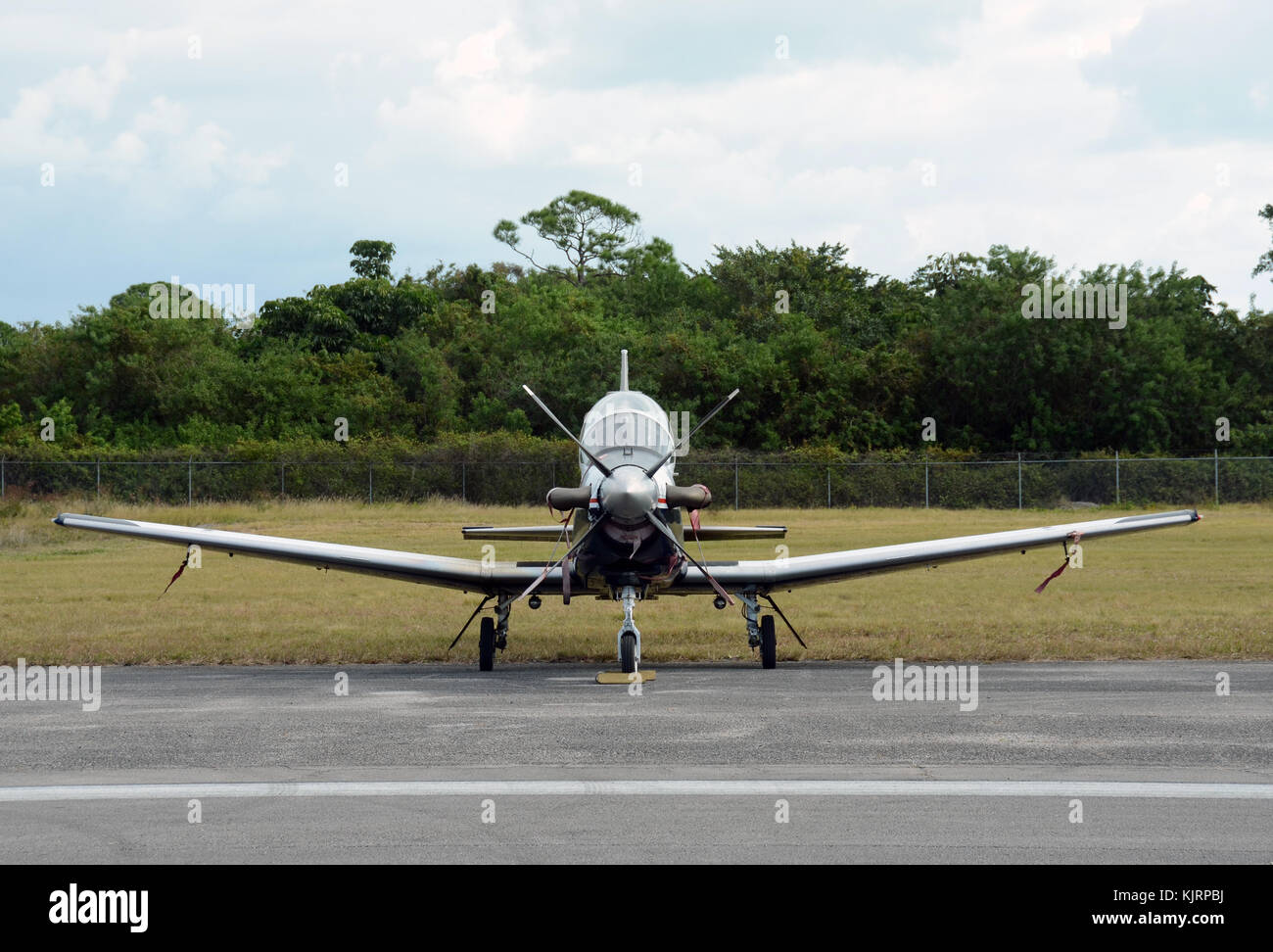 Modern single engine urboprop airplane front view - Stock Image