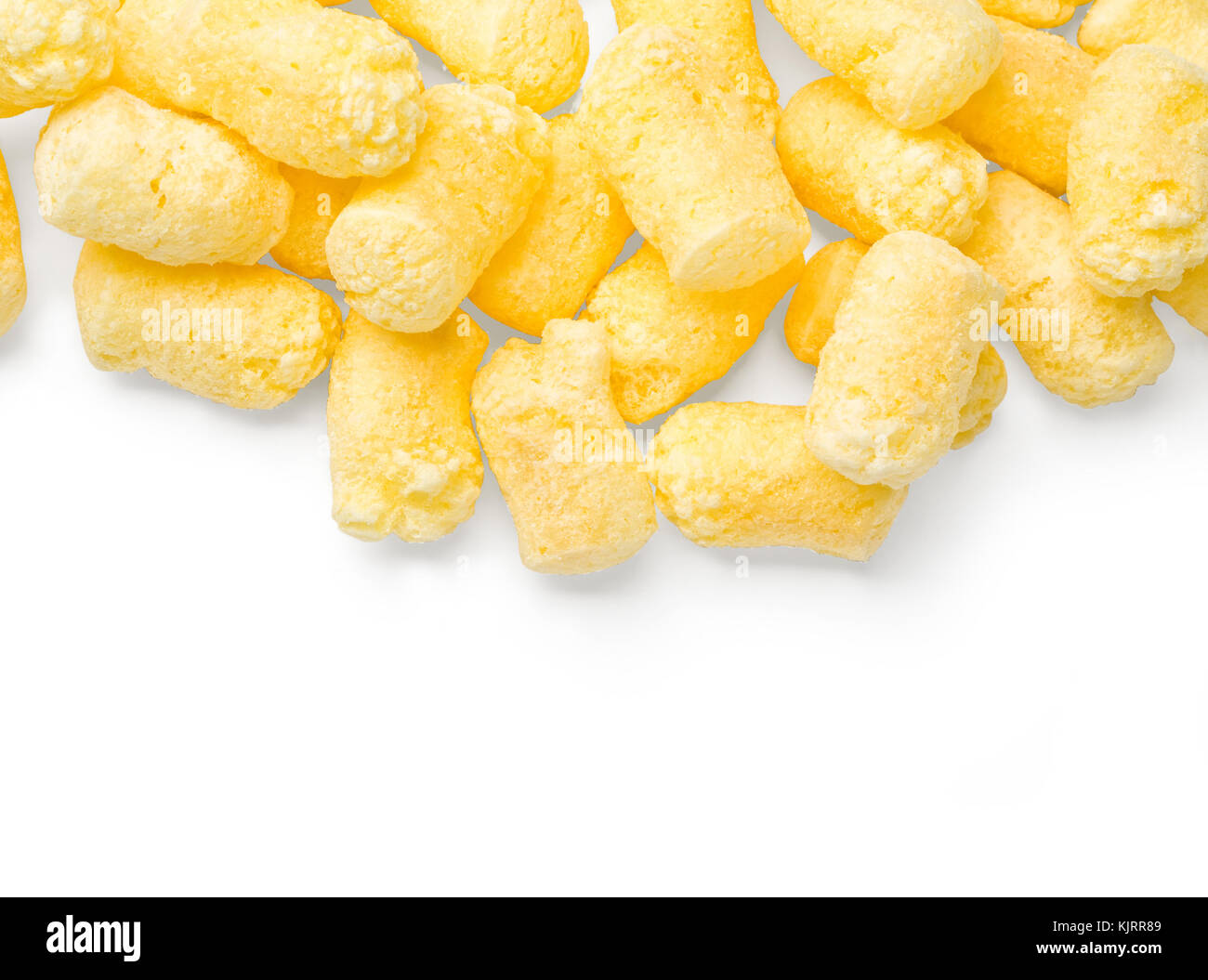 Crunchy corn snacks on white background. With clipping path - Stock Image