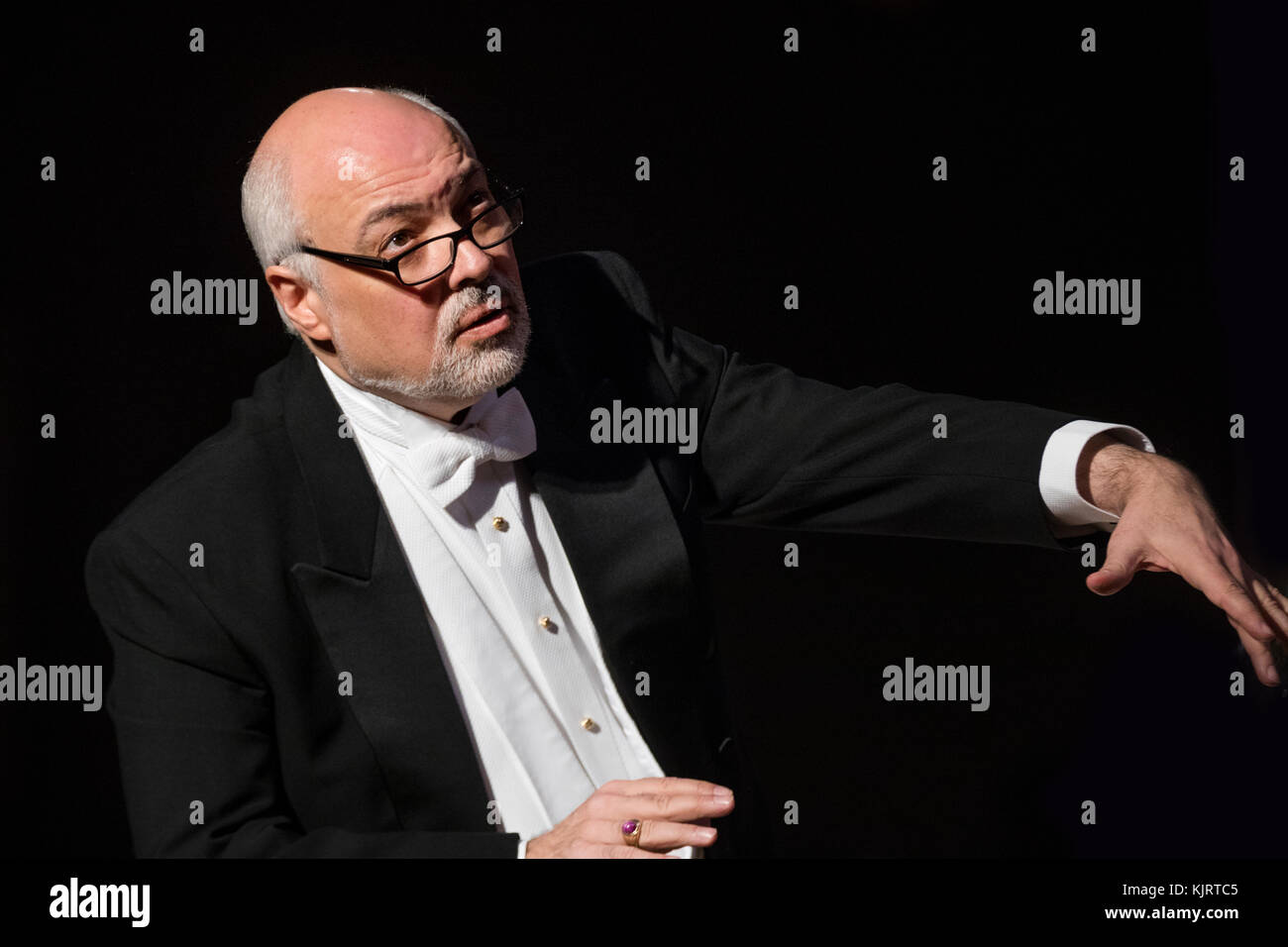 Conductor Constantine Orbelian on stage while conducting the orchestra - Stock Image