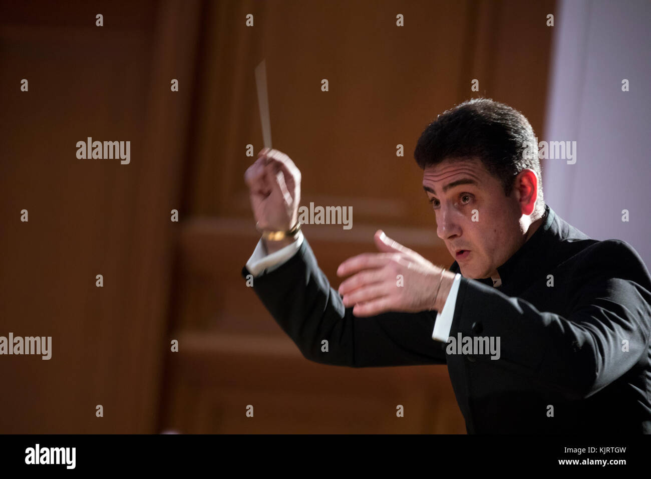 Conductor Eduard Topchyan on the stage of the Great Hall of the Conservatory in Moscow while conducting the orchestra, - Stock Image