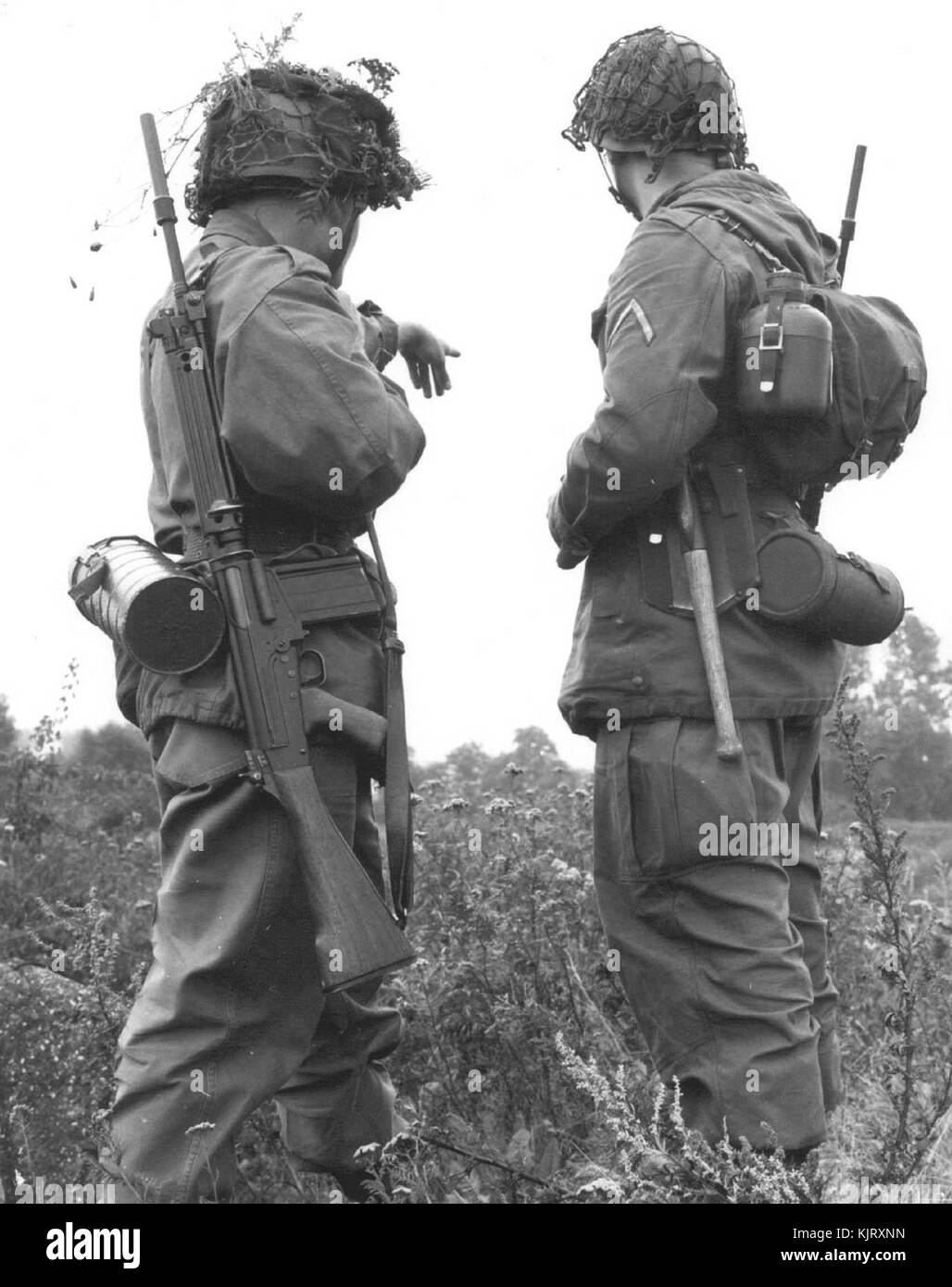 Two German soldiers on a joint exercise in 1960. West Germany used the FN FAL designated as G1. - Stock Image