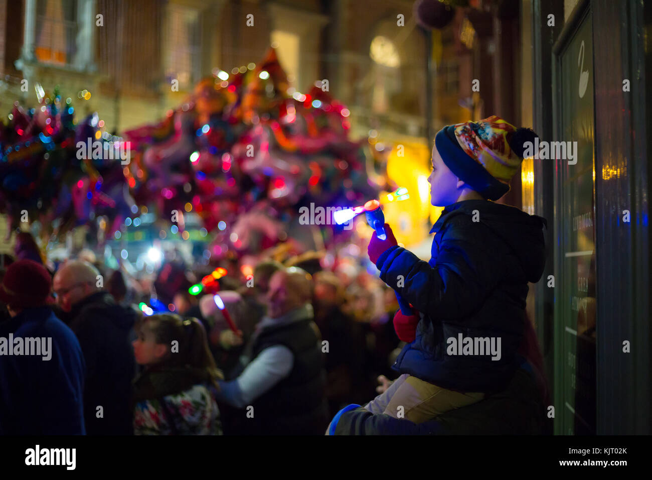 Kidderminster town switches on its Christmas lights as one delighted little boy joins in the fun perched high on - Stock Image