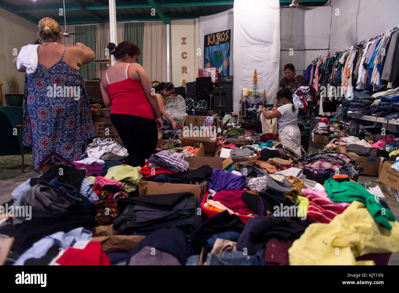 Puerto Rican residents pick up donated clothes at the