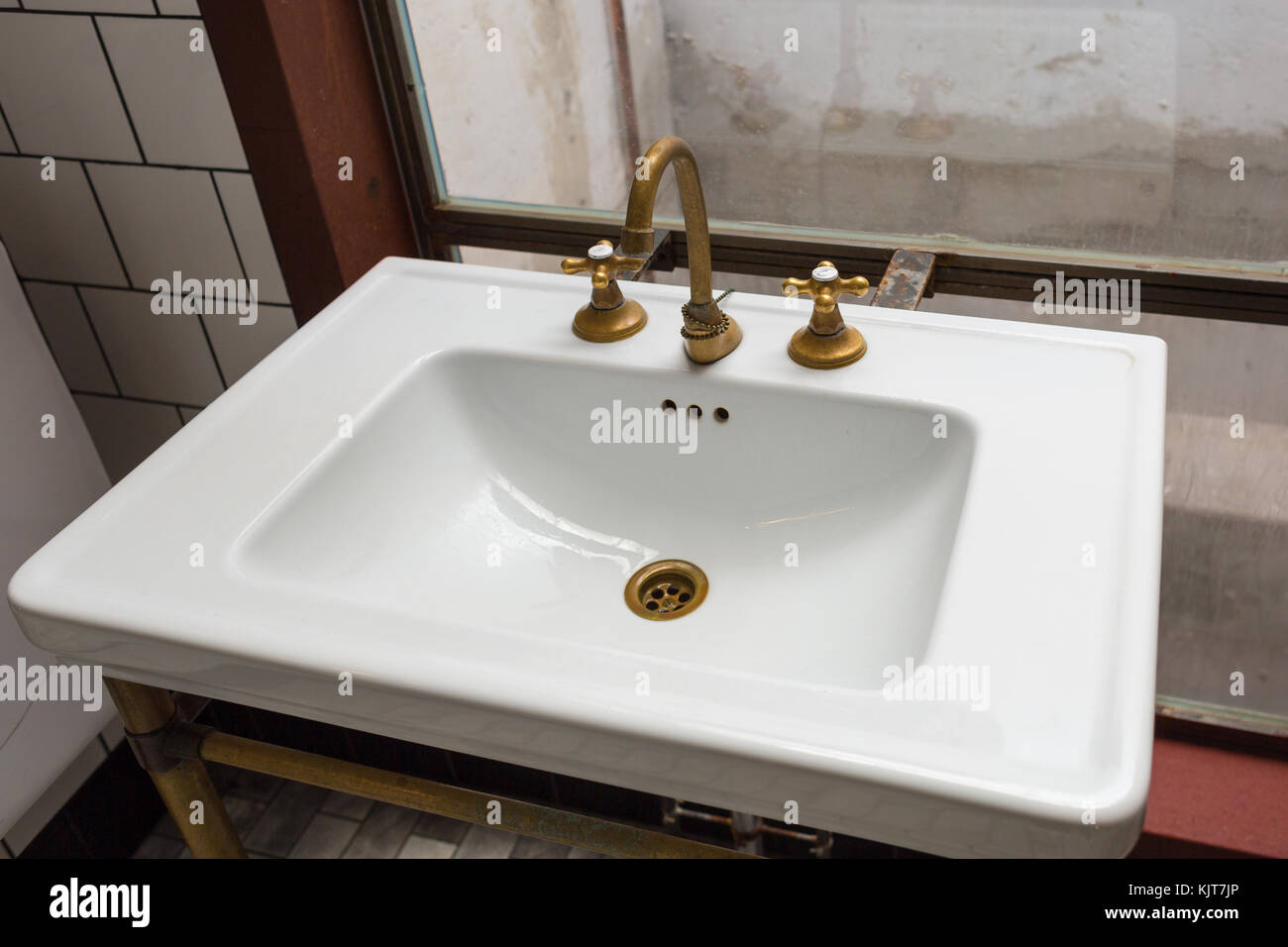 A vintage sink with golden separate tap and faucet Stock Photo ...