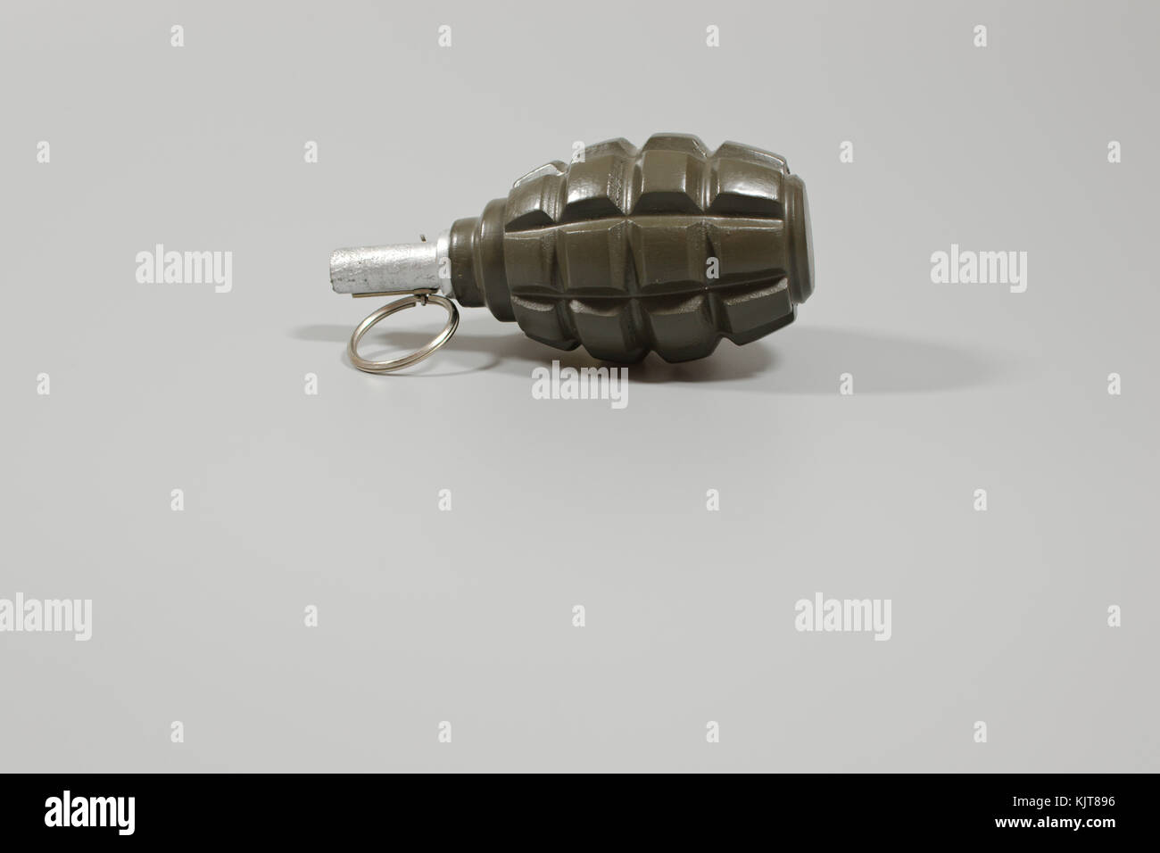 A hand grenade with copy space left for text. - Stock Image