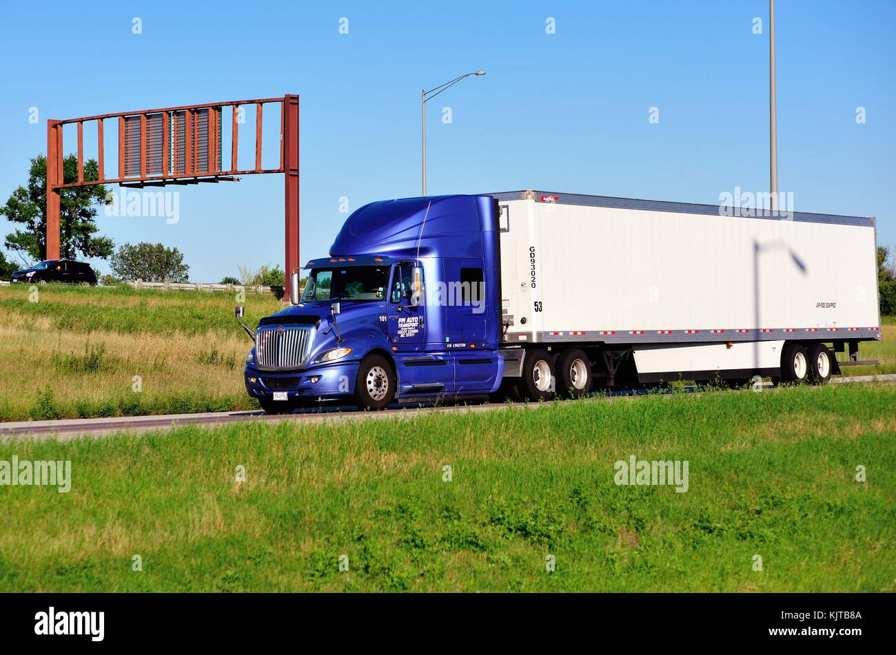 A semi-trailer or semi hauling content on a section of an Interstate highway, divided  highway system in  Addison, - Stock Image
