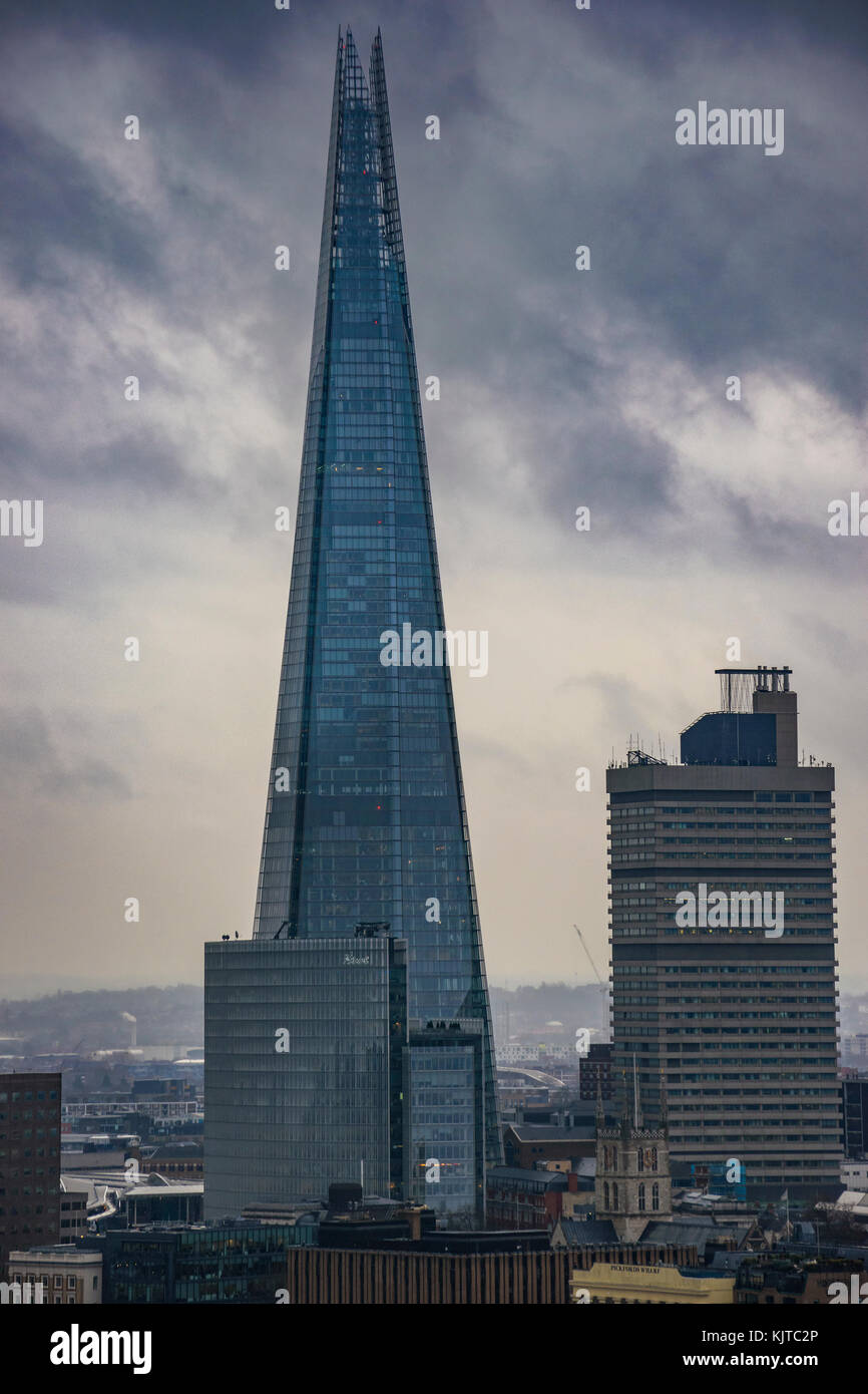 Modern architectural buildings and panoramic aerial view of urban London against a cloudy sky. - Stock Image