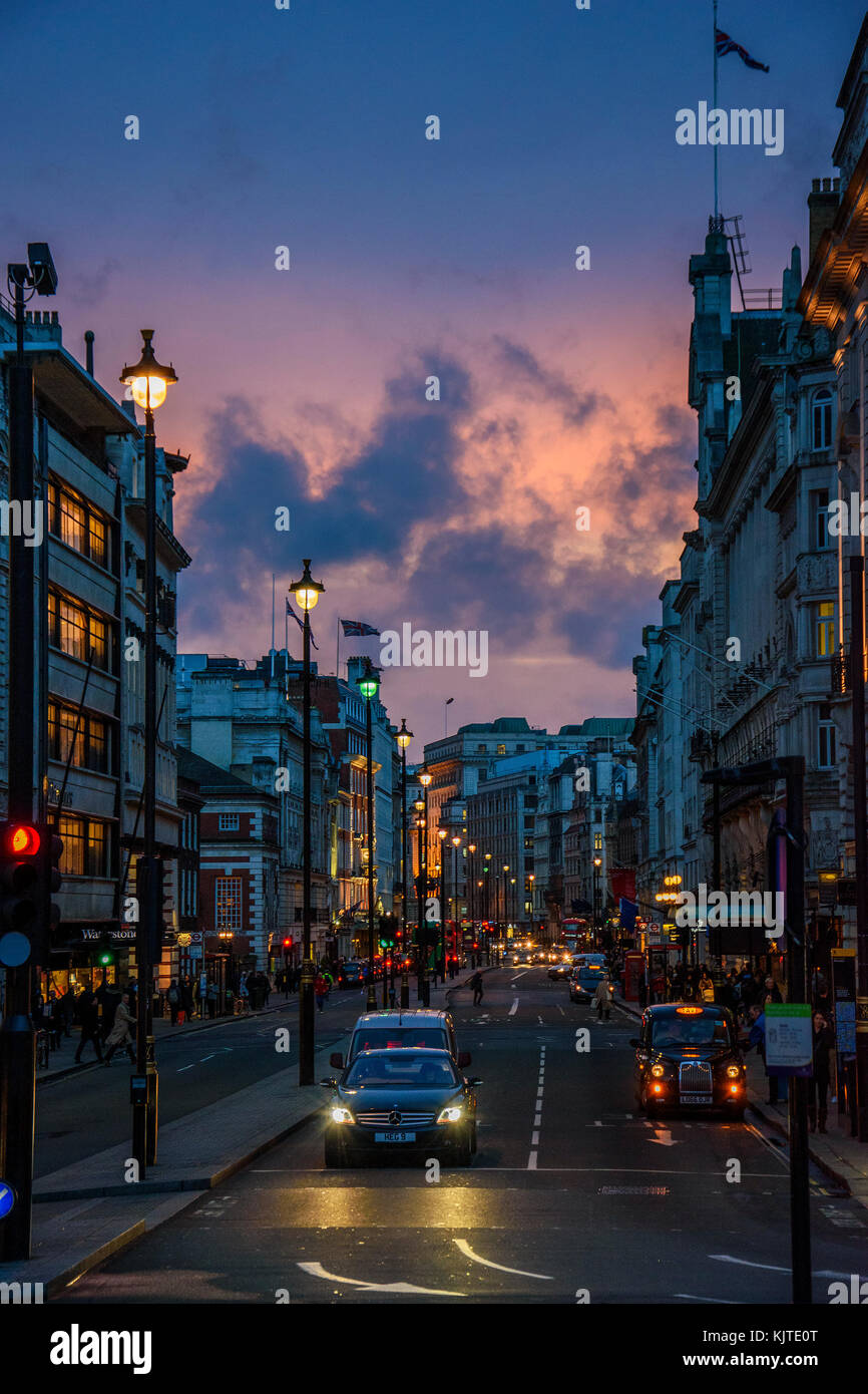 Wonderful cityscape view from central London. Traffic at Picadilly Circus square against a heavy cloudy sky. Street - Stock Image