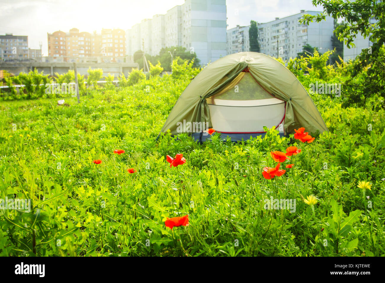 tent in the city in the background of a multistory building - Stock Image