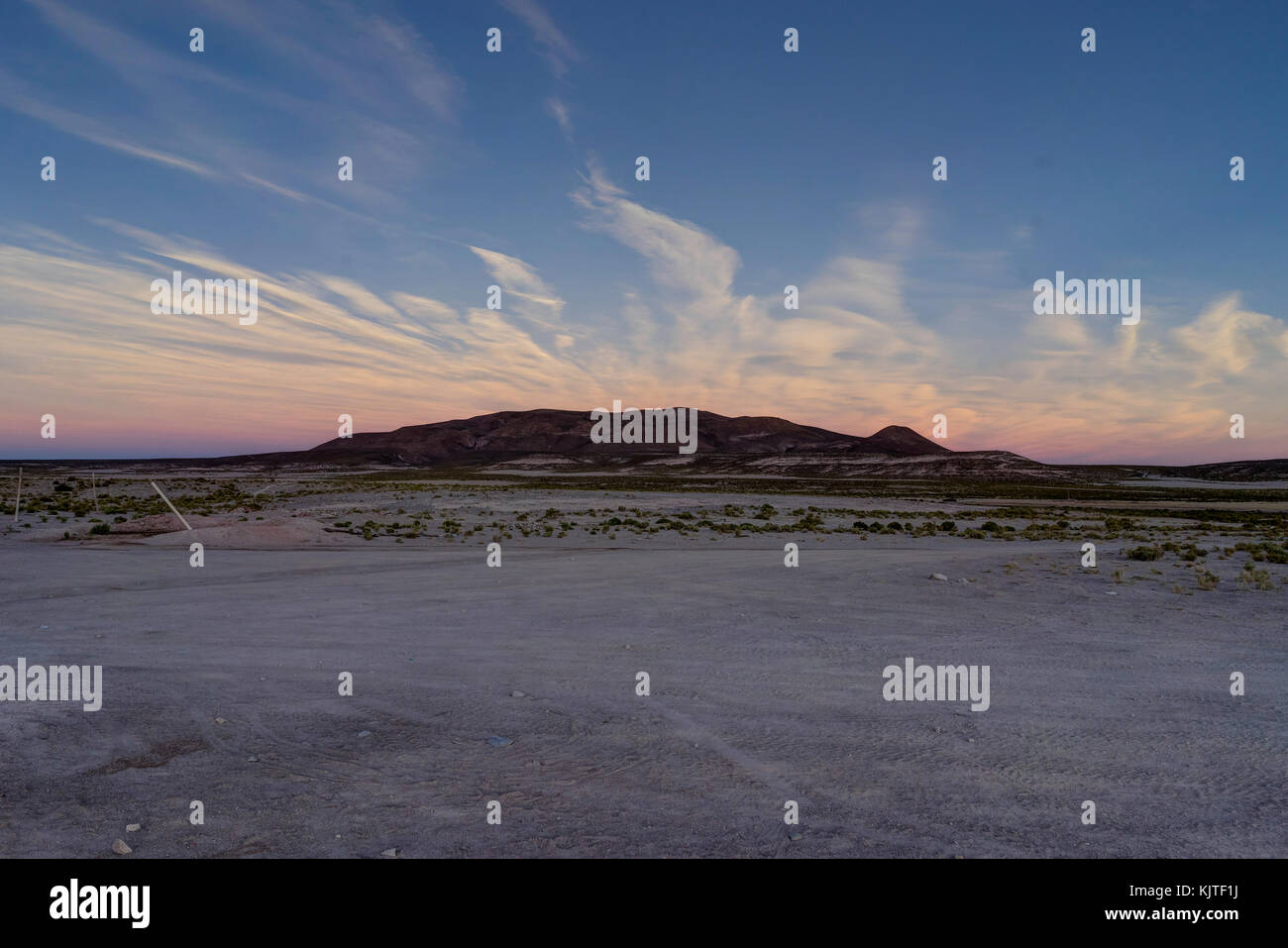 Photo taken in August 2017 in Altiplano Bolivia, South America: Sunrise Sunset Mountains View over Altiplano Desert - Stock Image