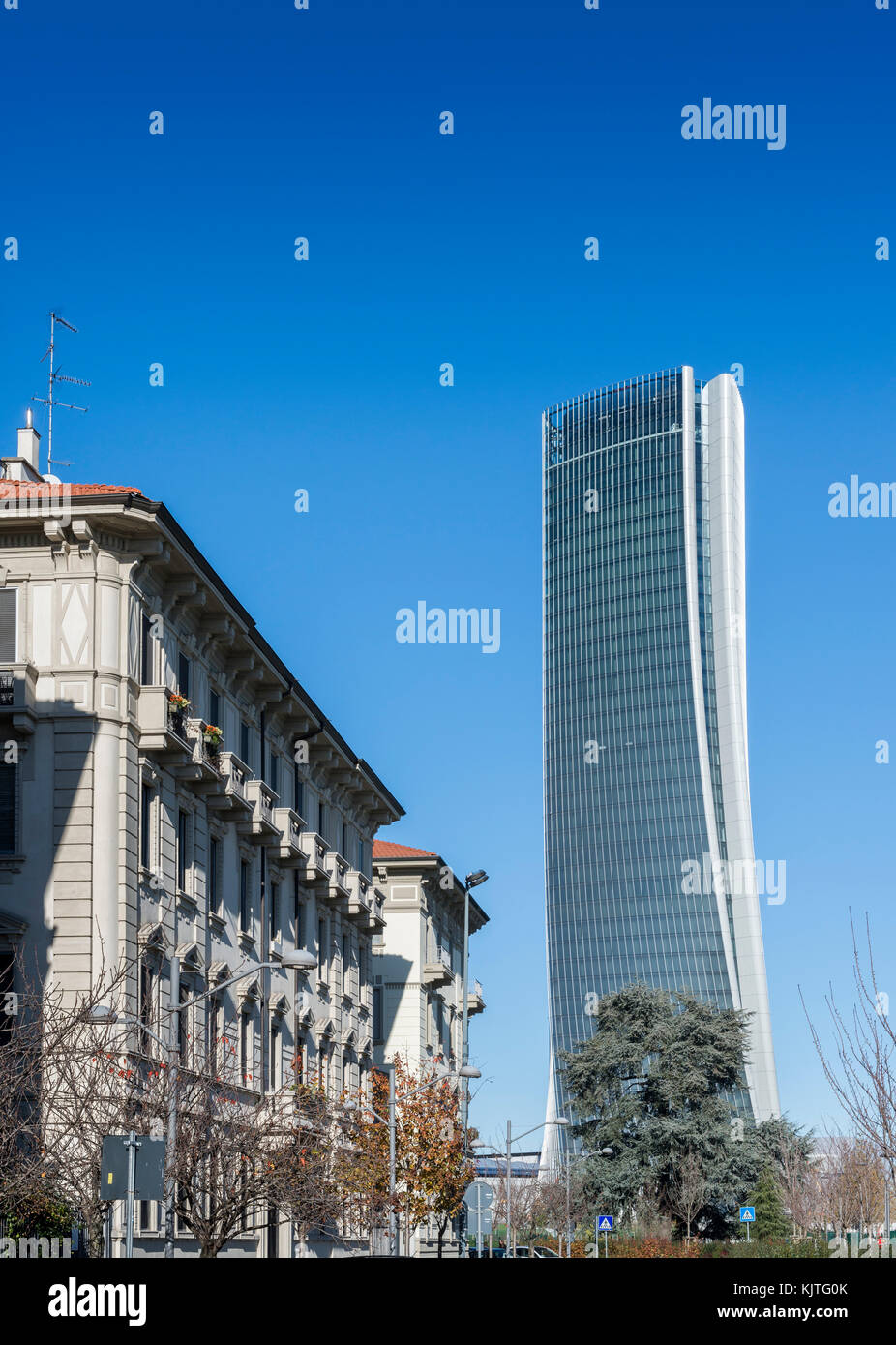 Italy, Lombardy, Milan, Skyline - Hadid Tower called Lo Storto with traditional architecture on left foreground - Stock Image