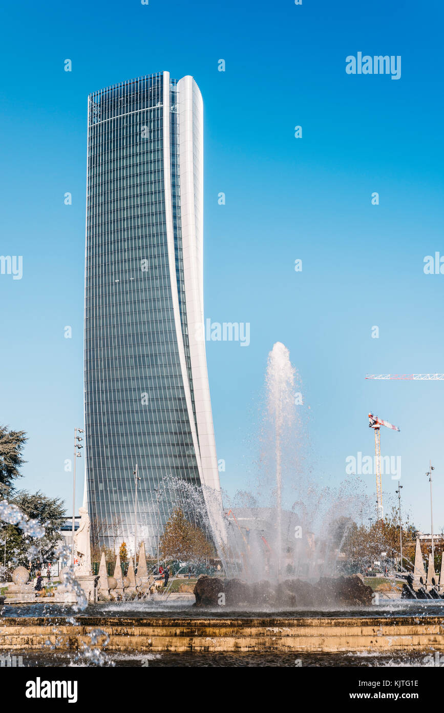 Italy, Lombardy, Milan, Skyline - Hadid Tower called Lo Storto with fountain geyser on foreground - Stock Image