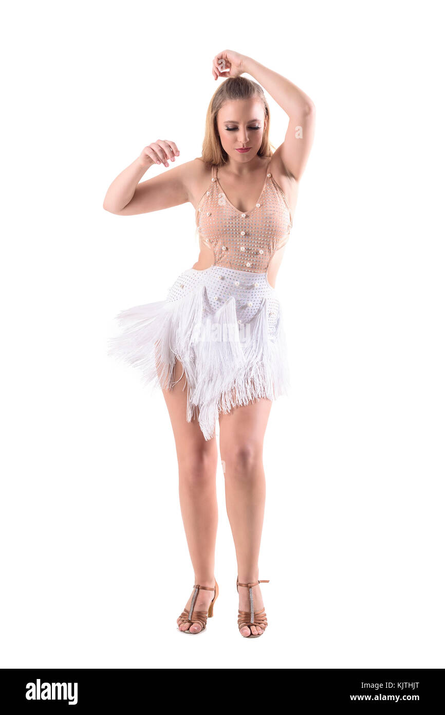 4ae623141 Professional skillful Latino dancer moving and dancing in traditional  competition dress. Full body length portrait isolated on white background.