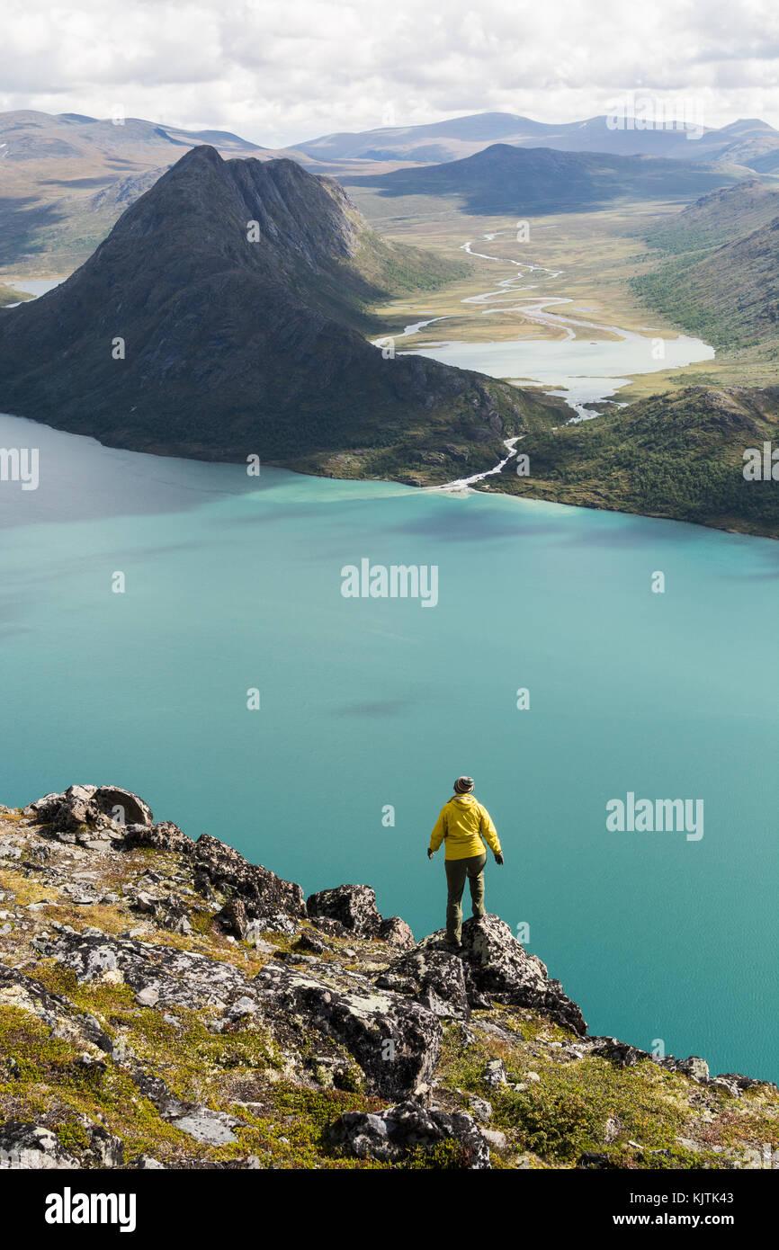 Girl standing on Besseggen ridge, Norway - Stock Image