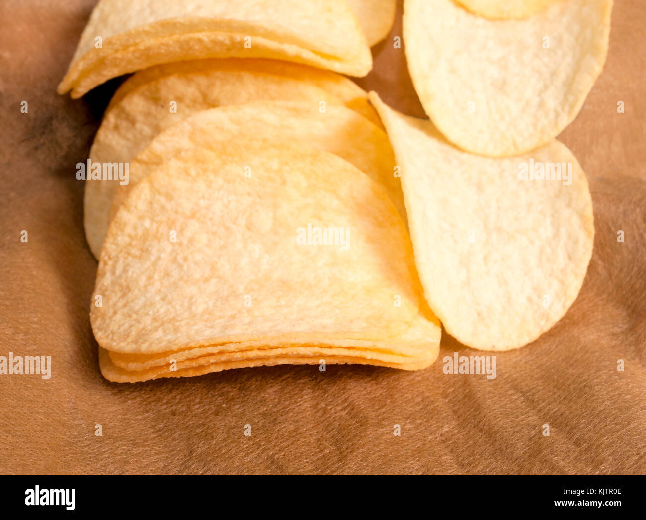 Selective focus on the front potato chips. - Stock Image