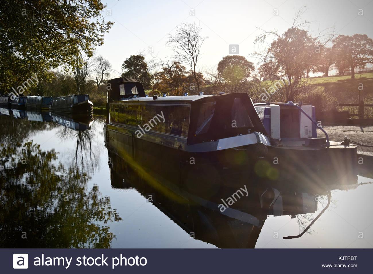 Narrowboat on a frosty autumn morning. - Stock Image