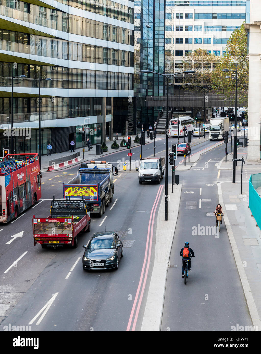 London, UK - Nov 22, 2017: Cyclists on safe segregated cycling lanes on Upper Thames Street in the City of London - Stock Image
