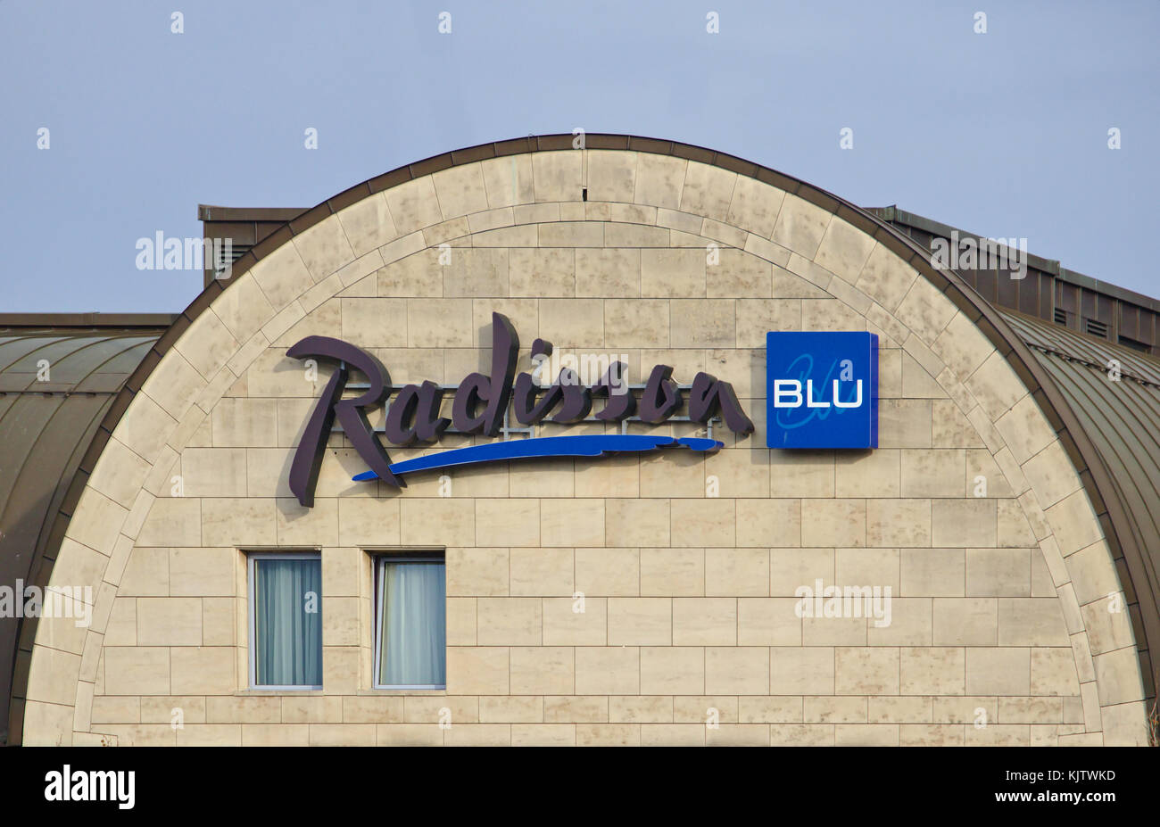 Bremen, Germany - November 23rd, 2017 - Gable of Radisson Blu hotel with large company logo - Stock Image