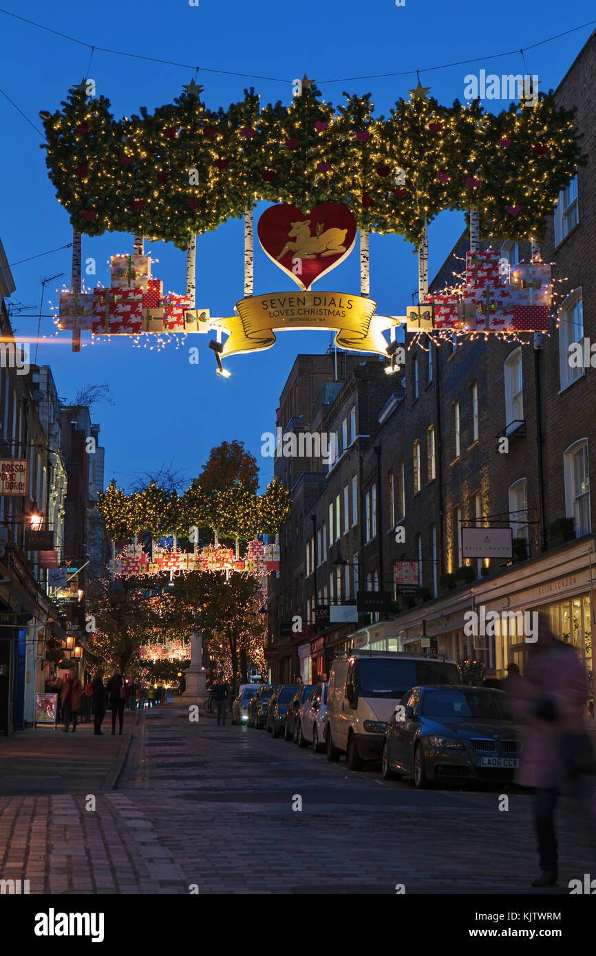 LONDON, UK - November 24th, 2017: Christmas lights on Seven Dials; seasonal lights are being displayed over fashionable - Stock Image