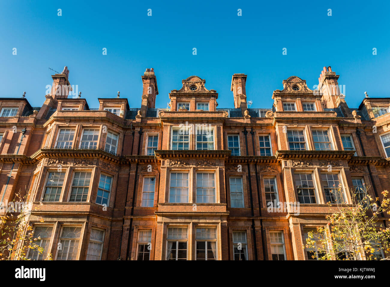 19th century buildings in Mayfair, London, UK on a sunny day - Stock Image