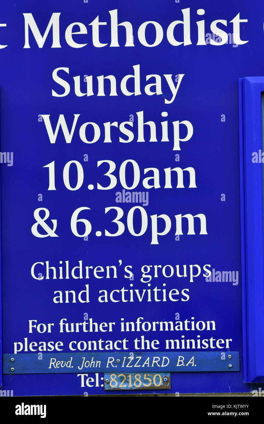 a Methodist church sign or religious advertisement advertising the weekly sunday service and worship including childrens - Stock Image