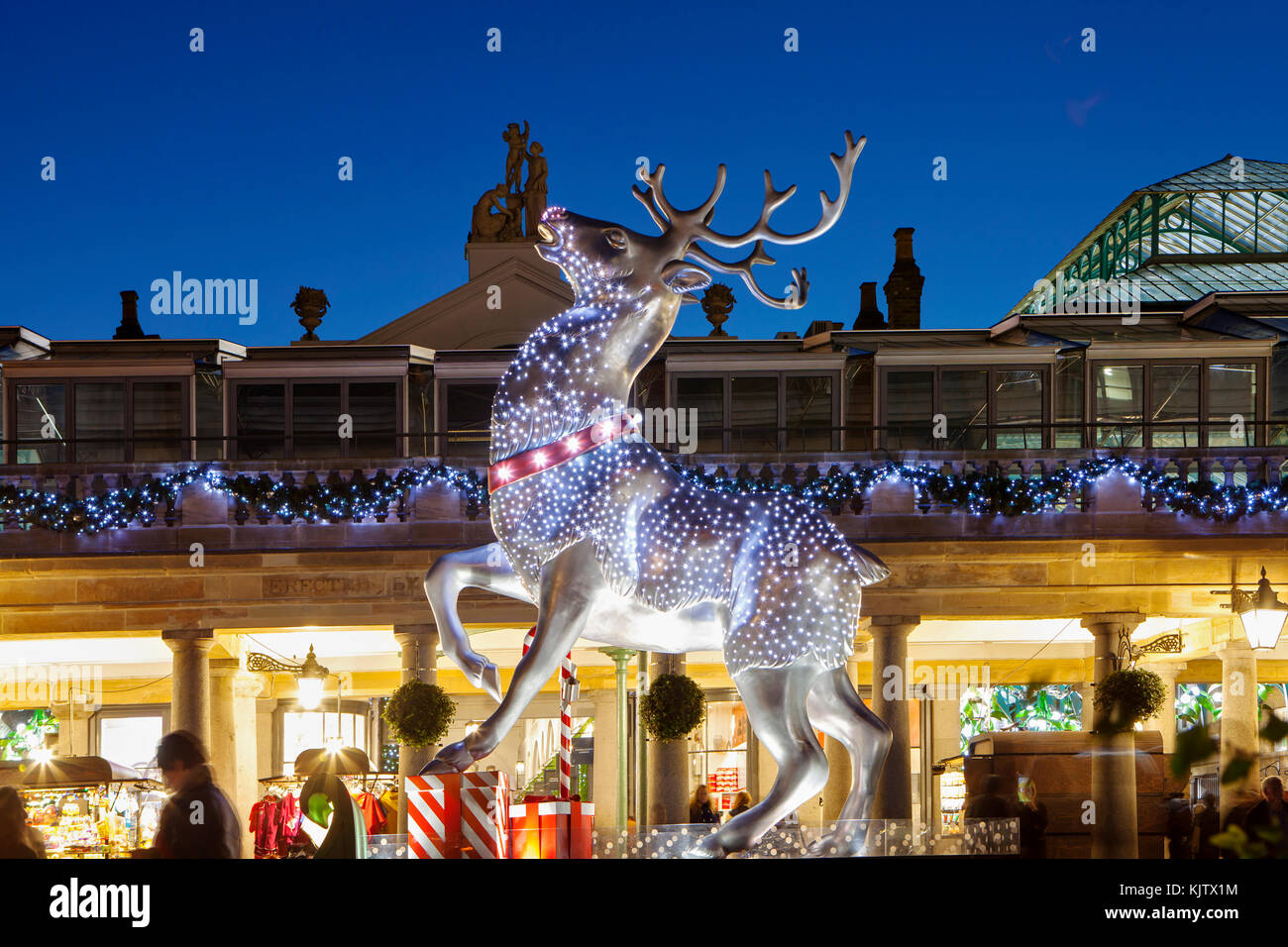 LONDON, UK - November 24th, 2017: Reindeer decoration  in Covent Garden; seasonal lights are being displayed over - Stock Image