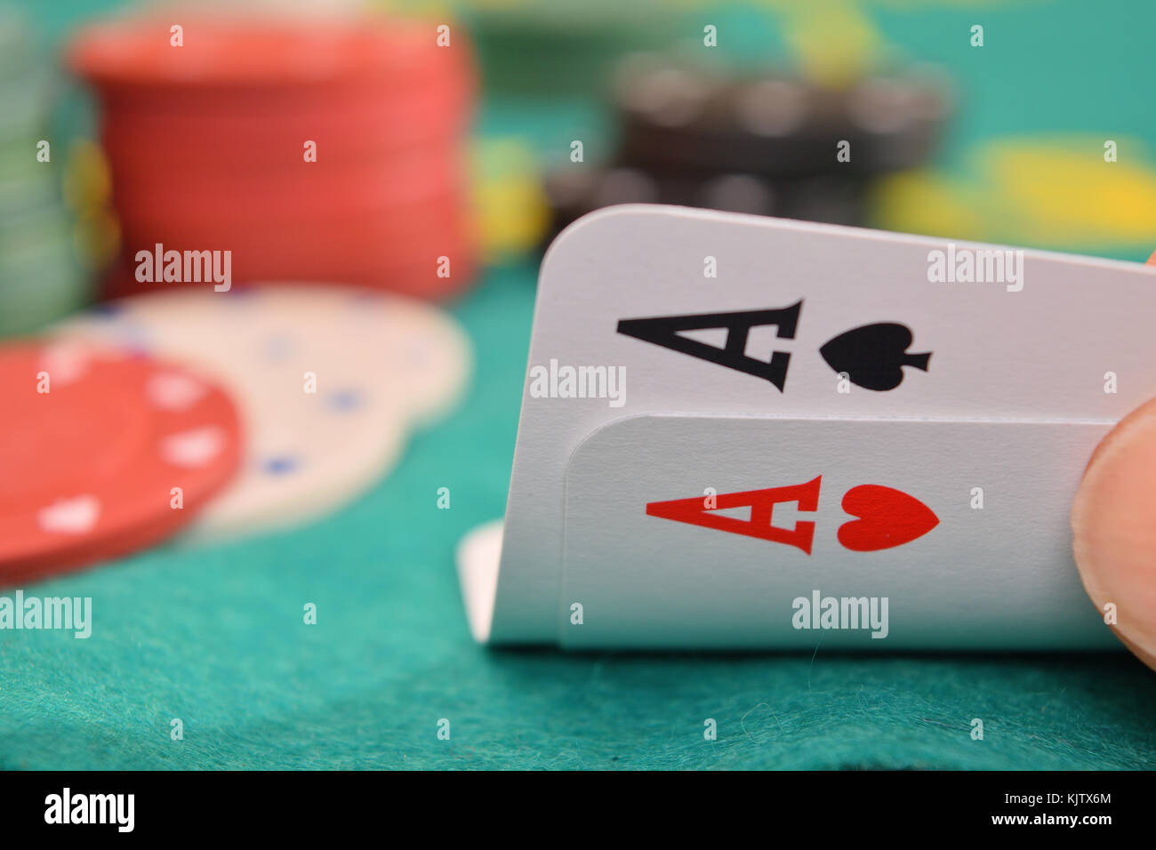 aces pair on a gambling table with chips - Stock Image