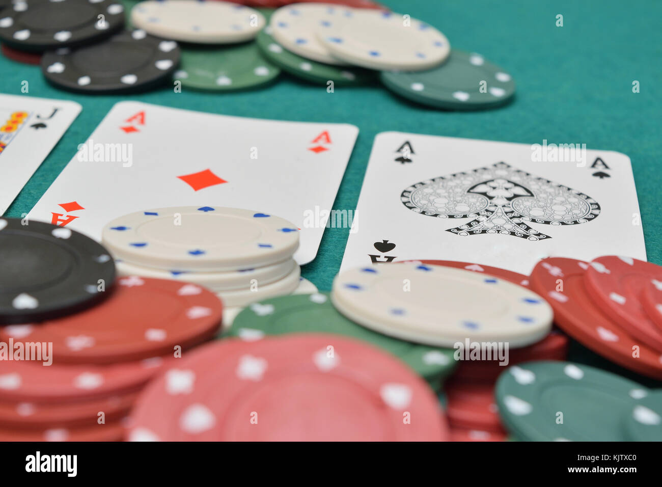 chips and cards on a gambling table with chips - Stock Image