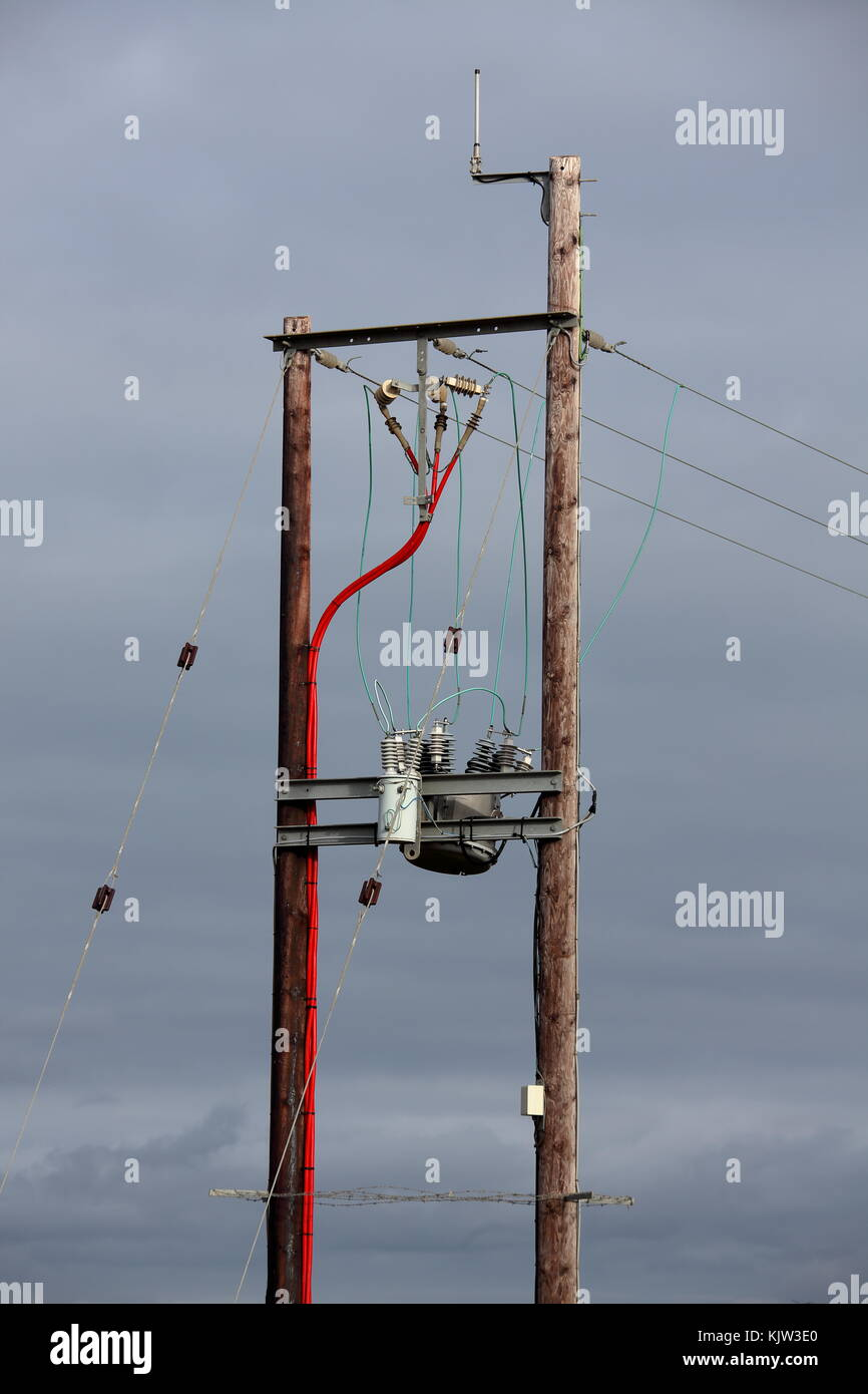 A high voltage connection point where overhead cable is reduced in voltage via transformer to go to domestic supplies - Stock Image