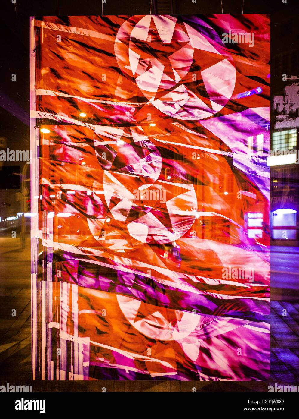 Munich, Bavaria, Germany. 26th Nov, 2017. North Korean flag collage in a vacant store window in wealthy Munich, Stock Photo