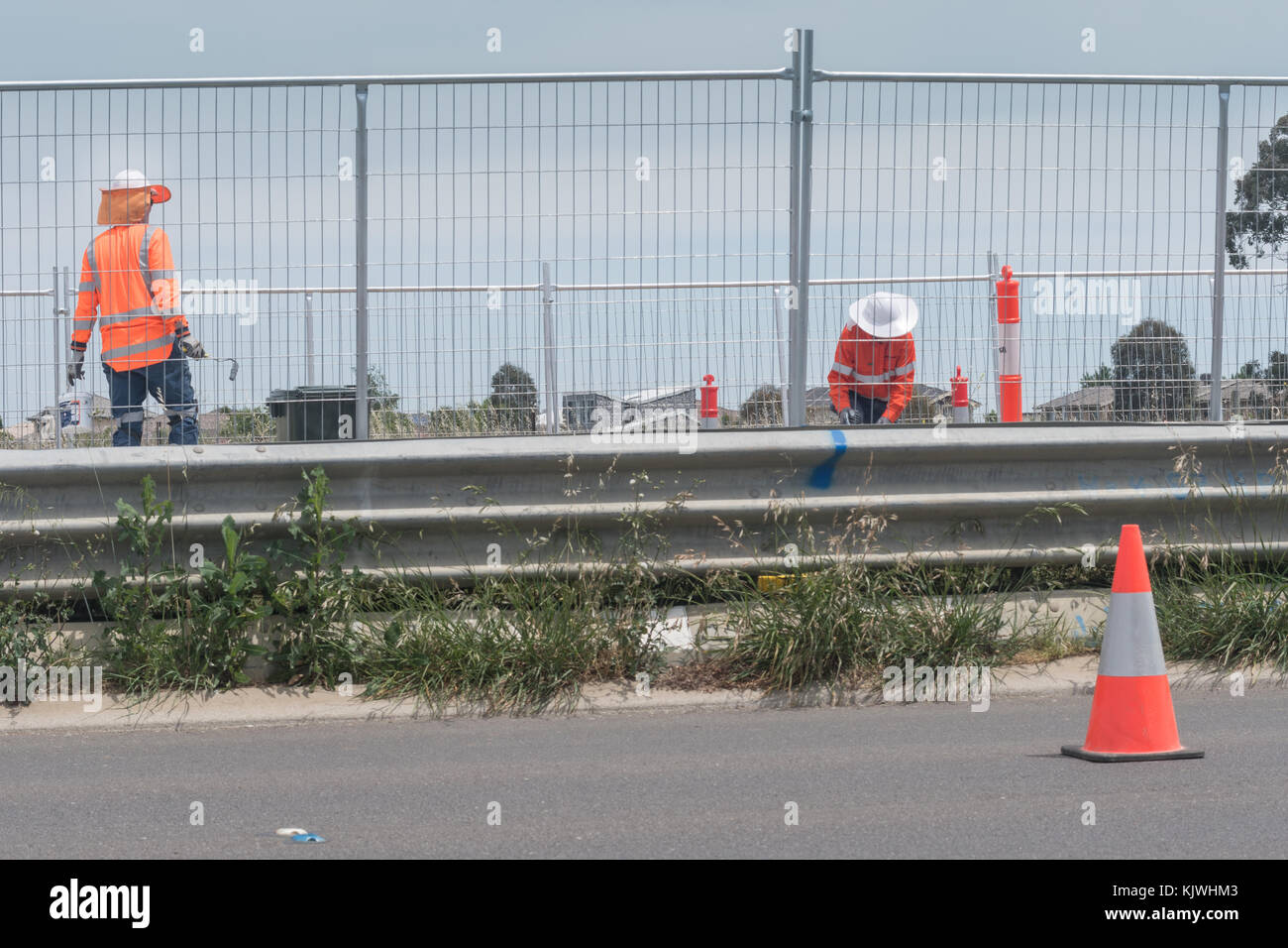 Couple of workmen working on the construction of the new light rail tram line between Gungahlin-Civic, Canberra, Stock Photo