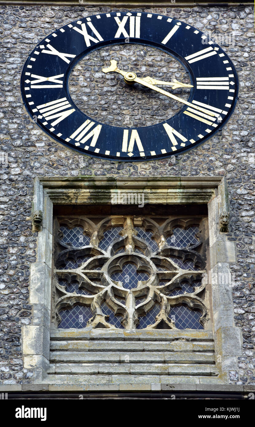 A beautiful old church clock or timepiece on the town church in Cromer in Norfolk with Roman numerals and a tracery - Stock Image