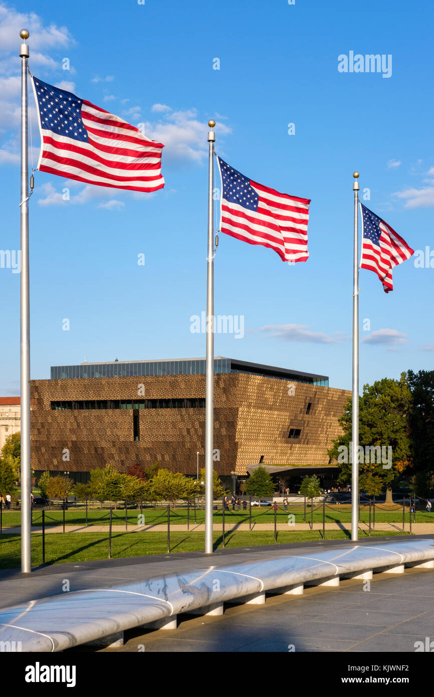 Smithsonian National Museum of African American History and Culture framed by three American flags, Washington, - Stock Image