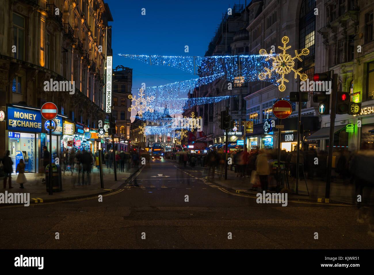 LONDON - NOVEMBER 25, 2017: Christmas lights on Coventry Street, London, UK. The Christmas lights attract thousands - Stock Image