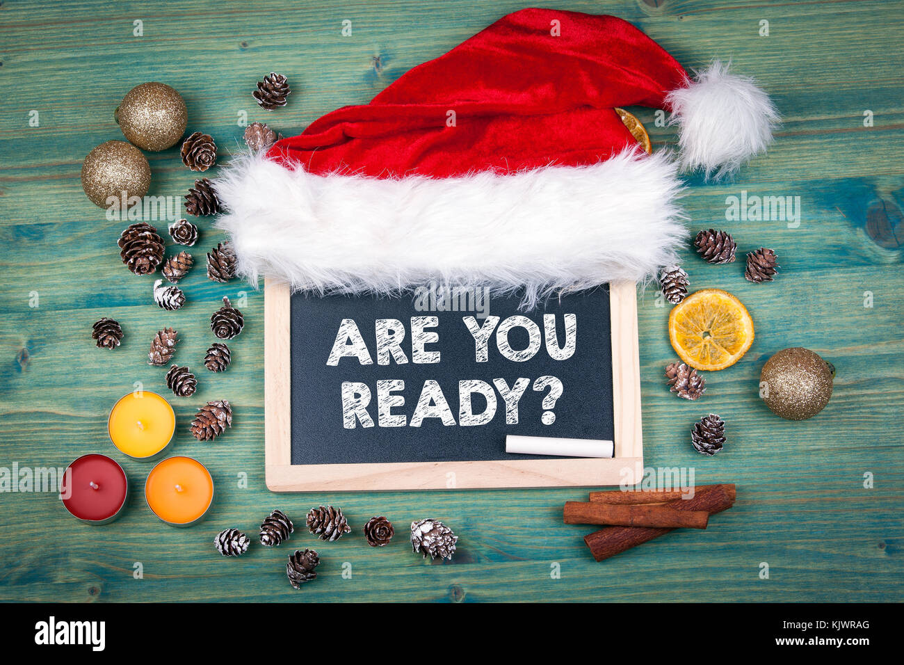 Are You Ready. Christmas and holiday background. Ornaments and decor on a wooden table - Stock Image