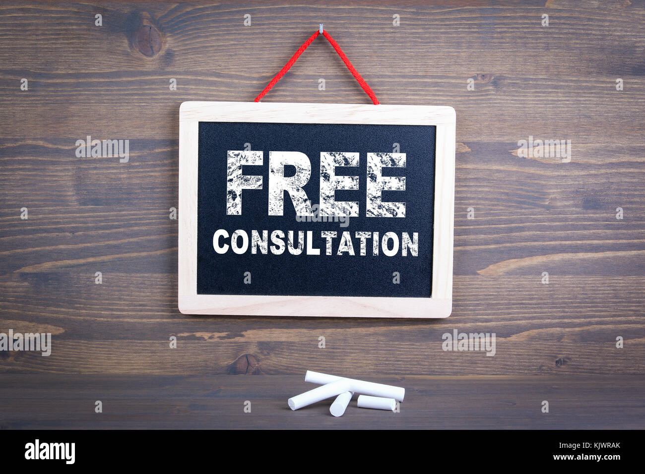 Free Consultation. Business success and customer service concept. Chalkboard on a wooden background  - Stock Image