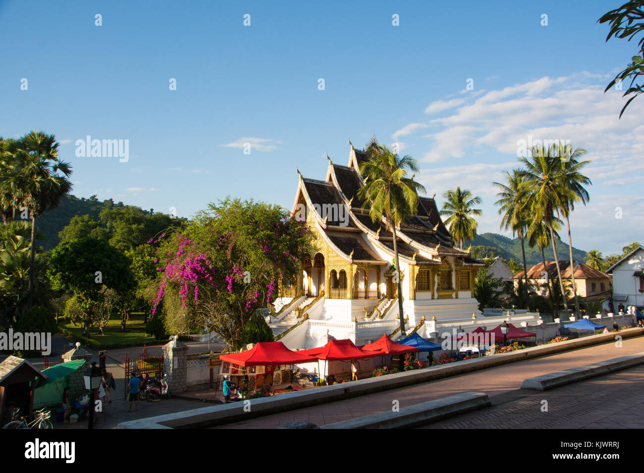 Beginning of the nightmarket in Luang Prabang at sunset - Stock Image