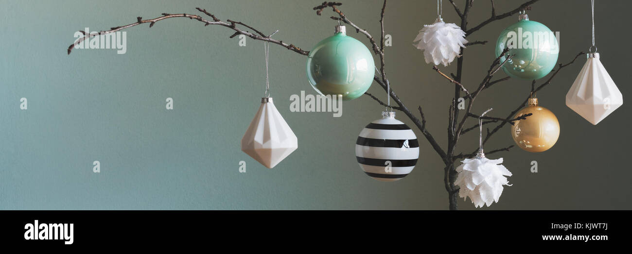Modern and elegant simple nordic christmas tree decorations in black, white, gold and turquoise colors Stock Photo