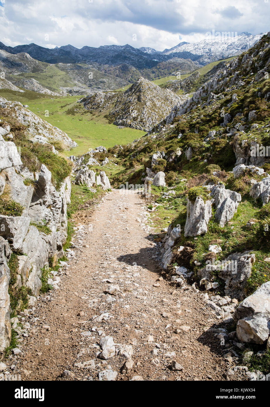 Track descending into the foothills of the Picos de Europa near Bobia and the Covadonga Lakes  in northern Spain - Stock Image