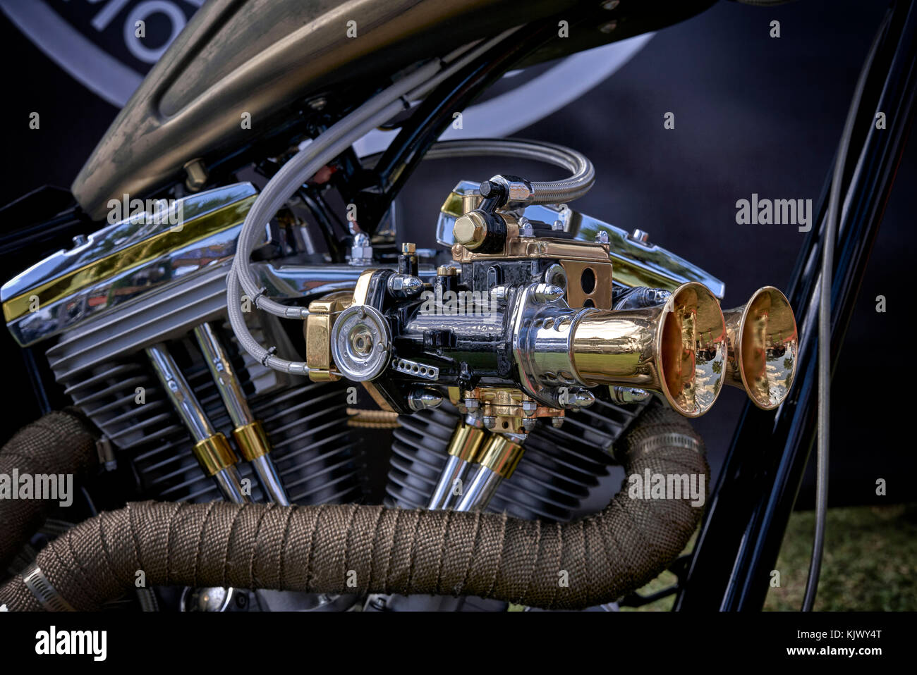 Ram pipes and Carburettor detail of a custom Harley Davidson chopper Motorcycle closeup. - Stock Image