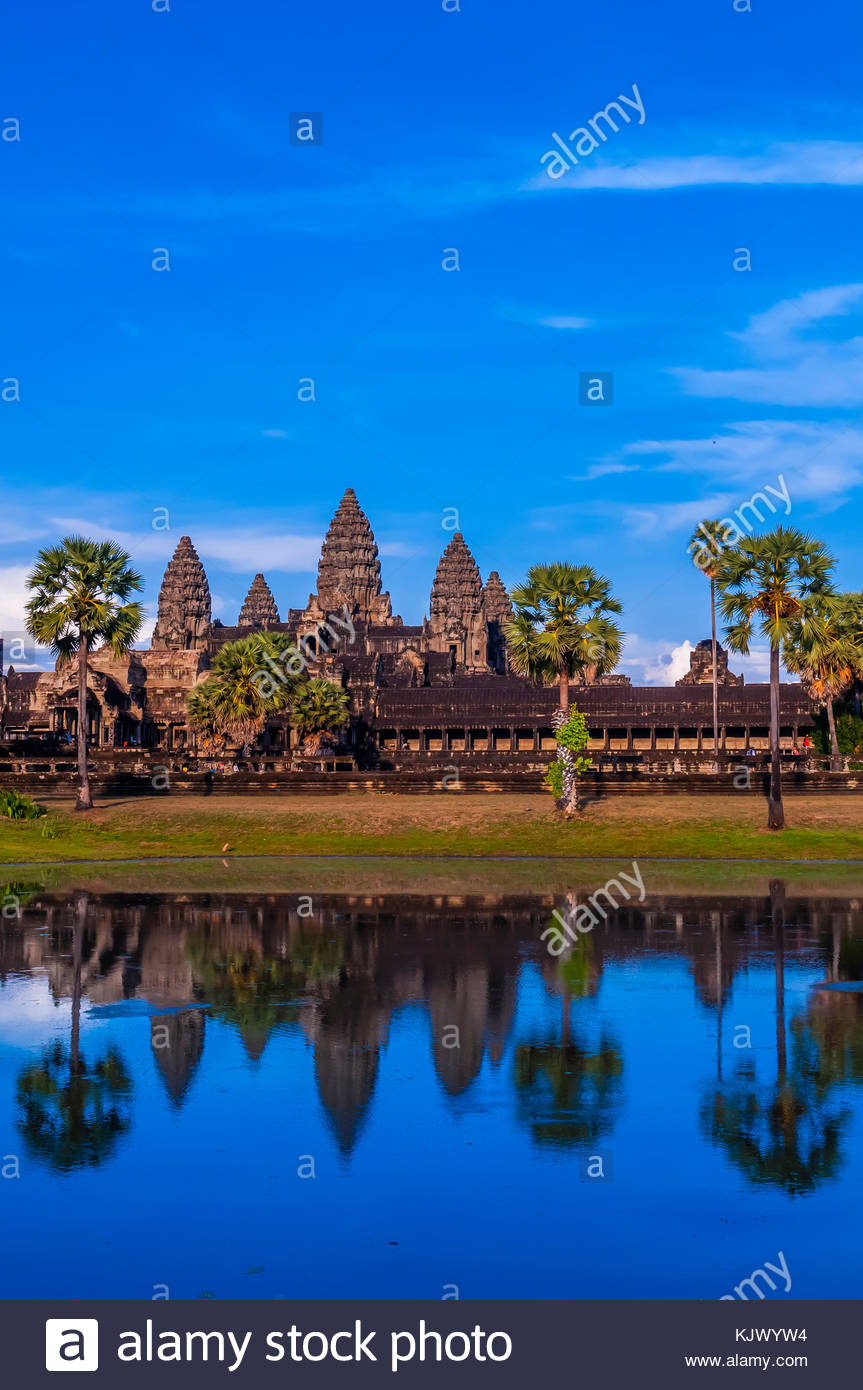 View of Angkor Wat with pond. It is the largest religious monument in the world. It's name means City which is a Stock Photo