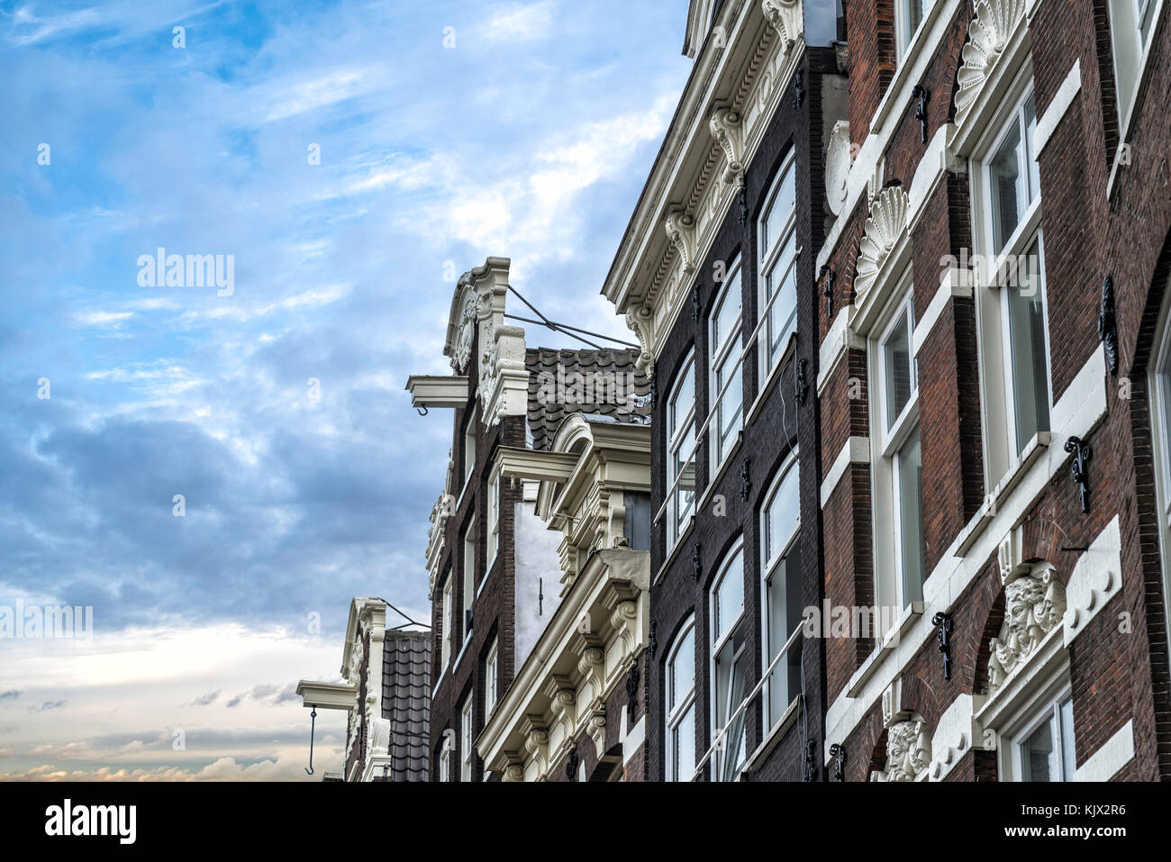 typical Amsterdam house with a hook on a beam under the roof for lifting furniture during a move. - Stock Image