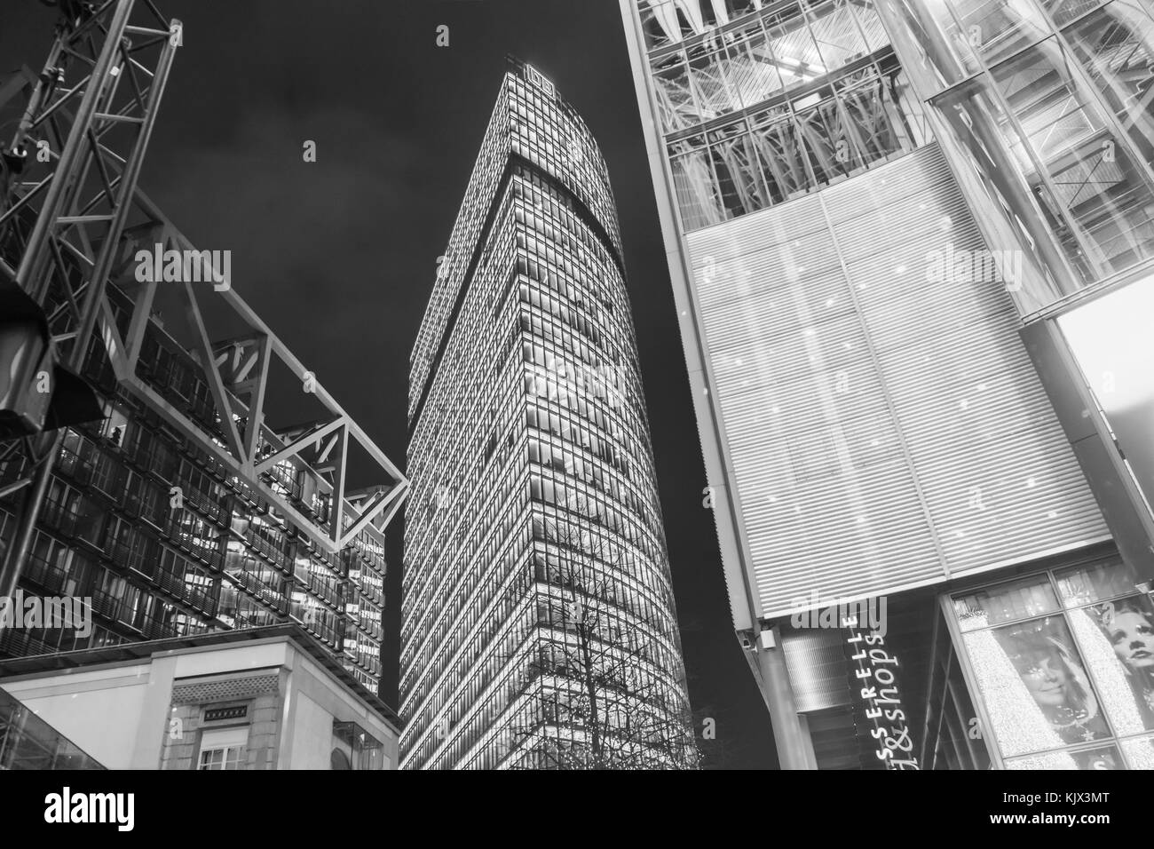 Black and white of the Bahn Tower (Bahntower) at Potsdamer Platz during nighttime in Berlin as seen from the Sony - Stock Image