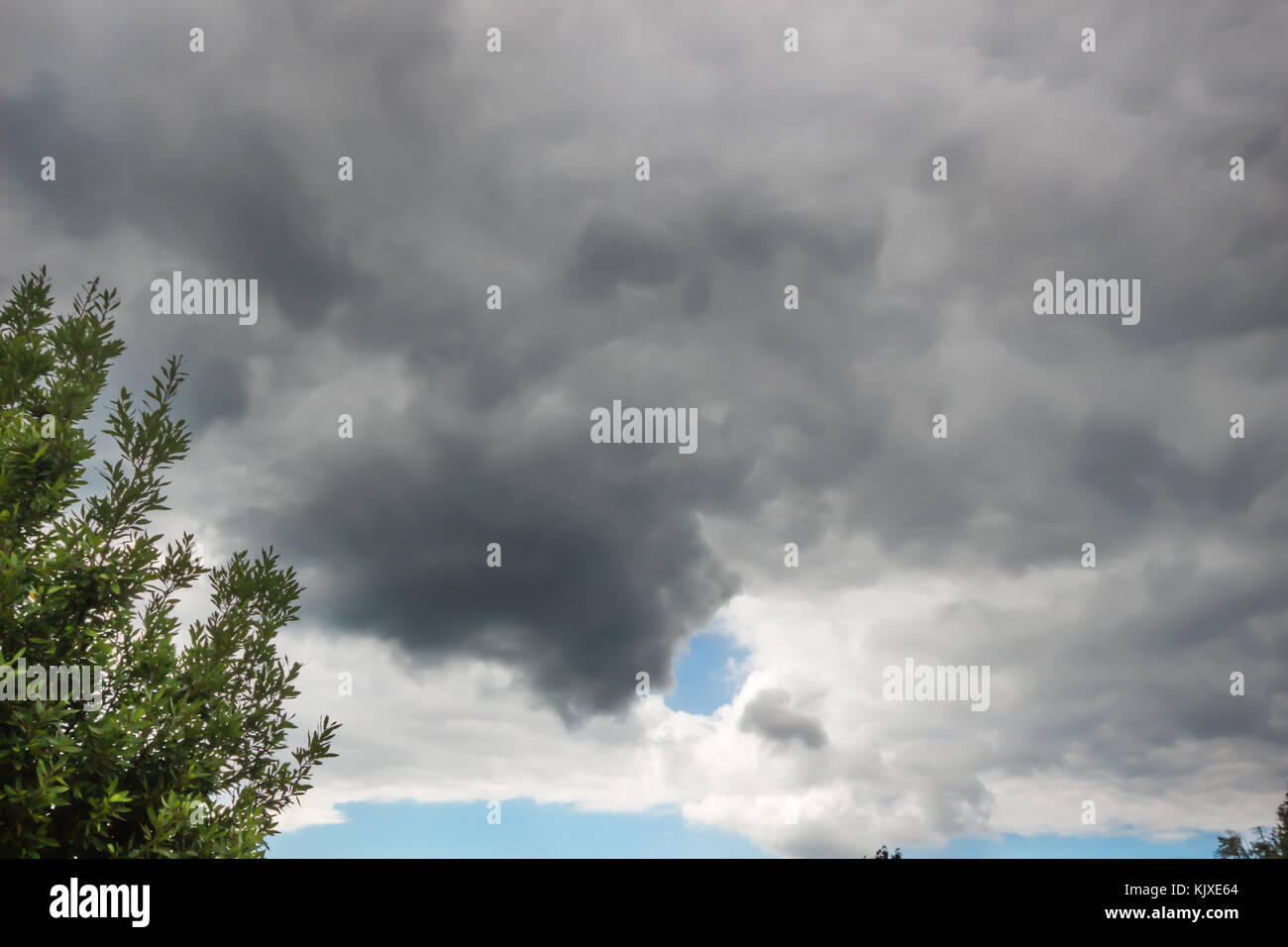 Dark clouds or rain cloud before a thunderstorm background. - Stock Image
