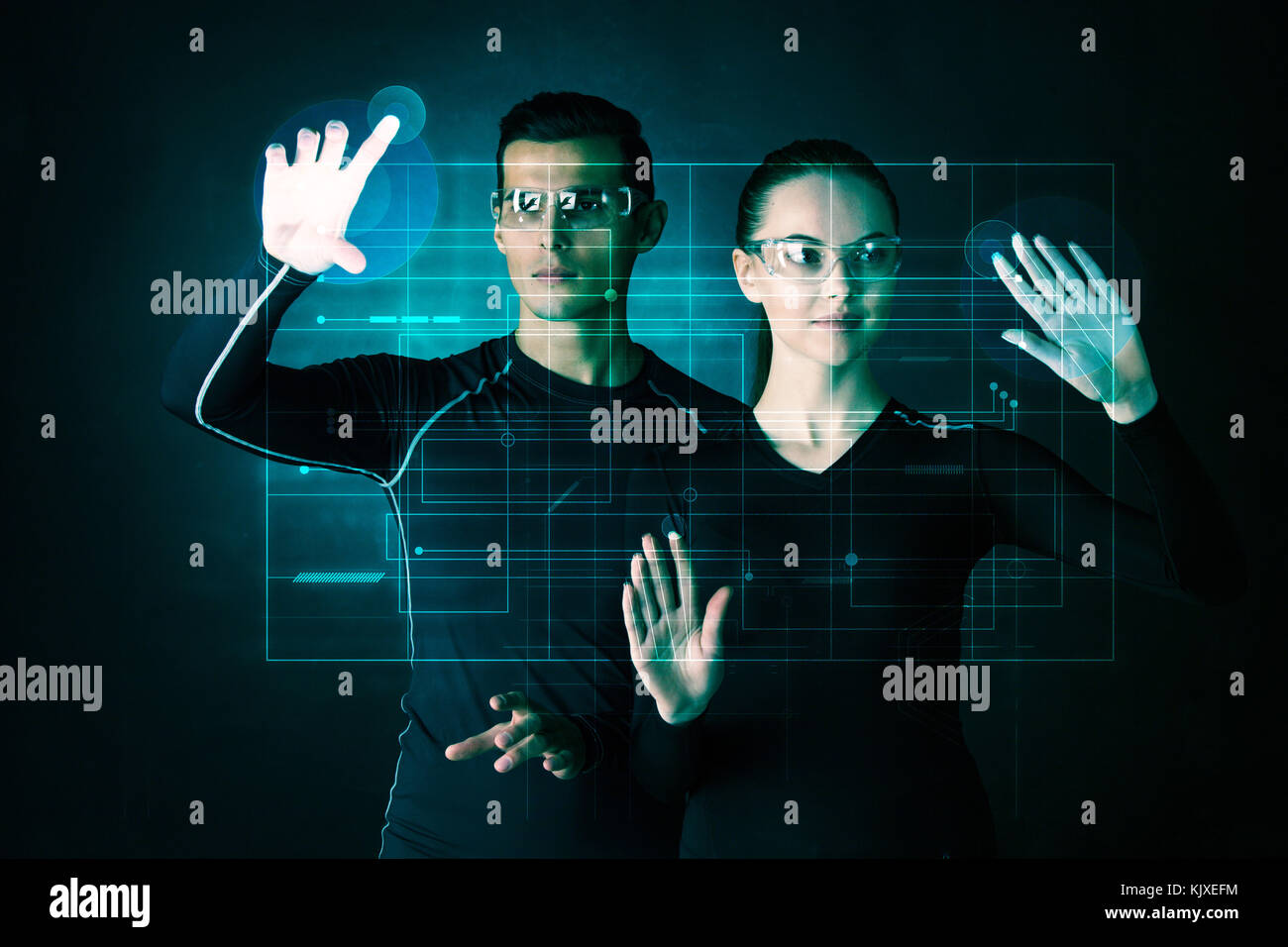 Couple working with futuristic display, innovation, future concept, abtract glowing outline - Stock Image