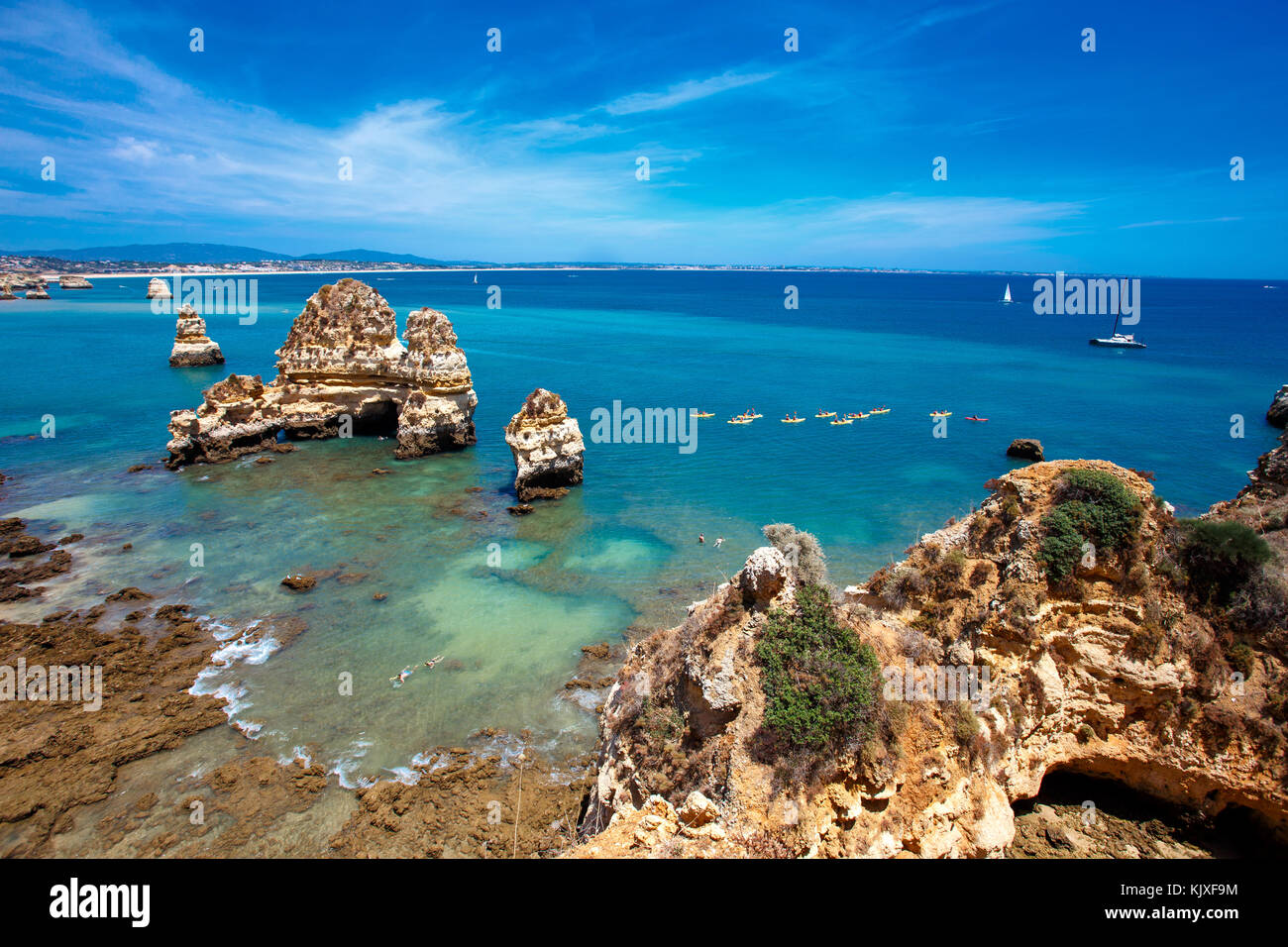 Famous Rocks in Sea, Ocean, Lagos in Portugal. Popular summer travel destination and famous beach. Ponta da Piedade - Stock Image