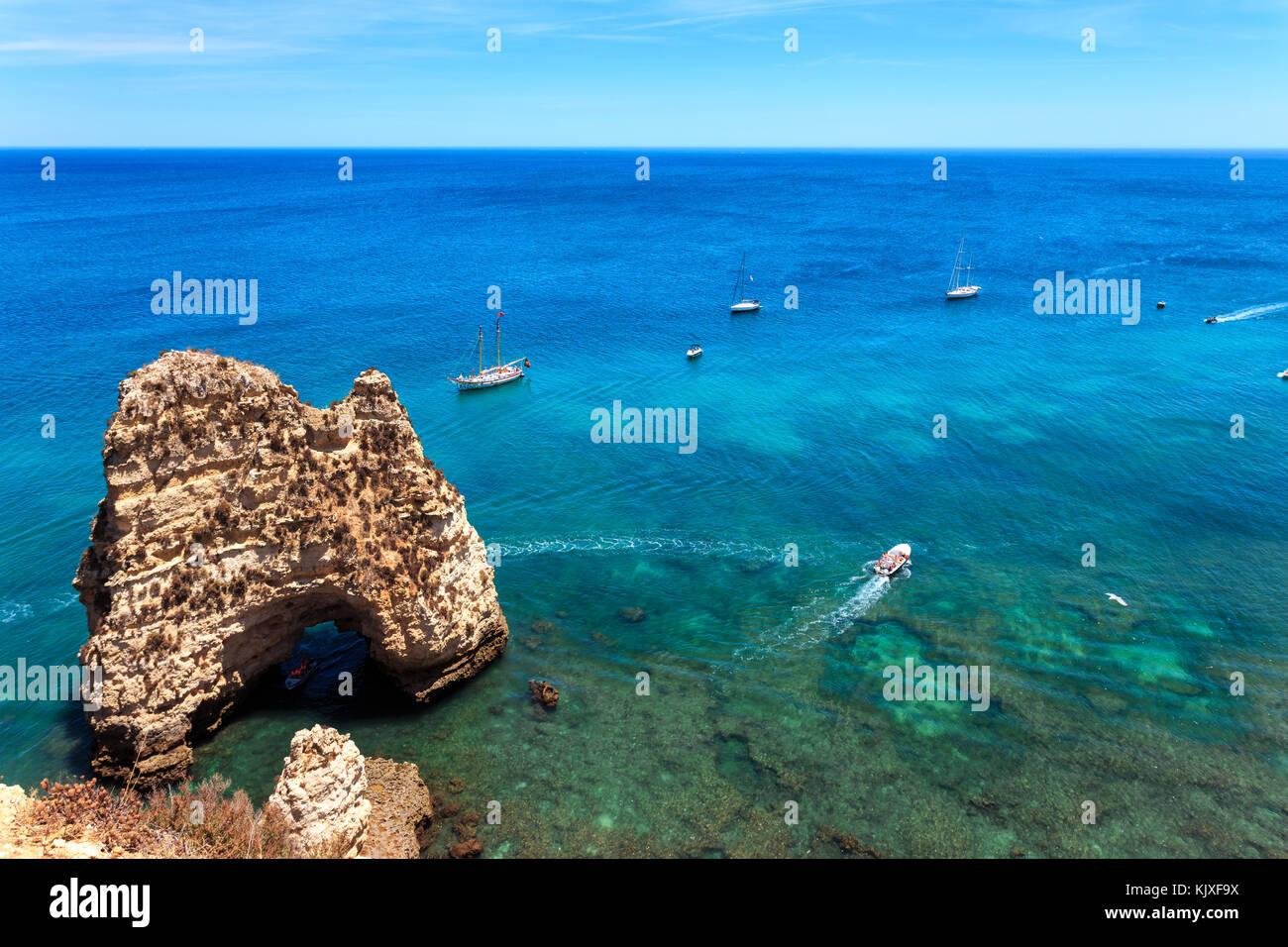 Famous Rocks in Sea, Ocean, Lagos in Portugal. Popular summer travel destination and famous beach. Ponta da Piedade - Stock Image