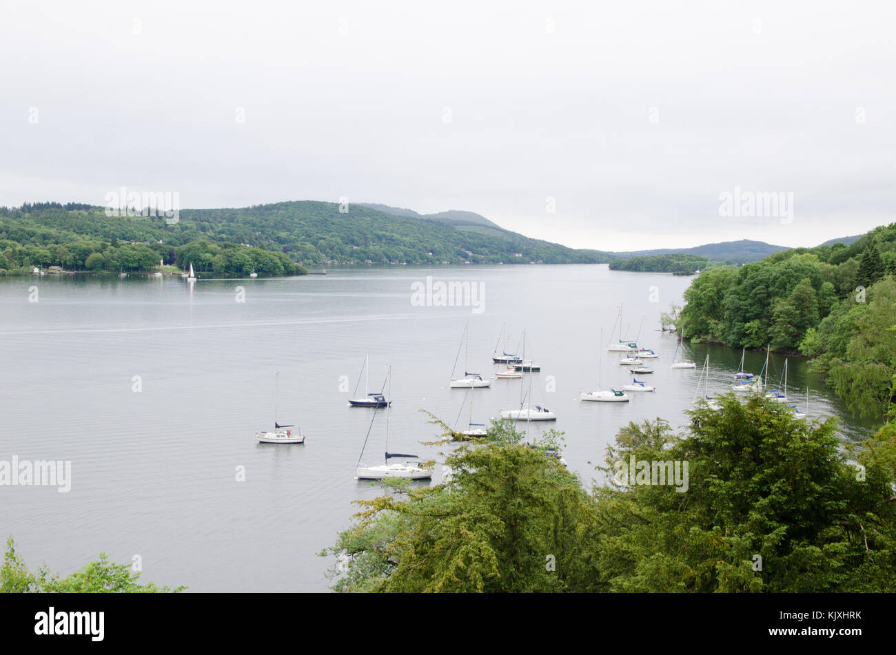 Boats moored on Lake Windermere in the English Lake District - Stock Image