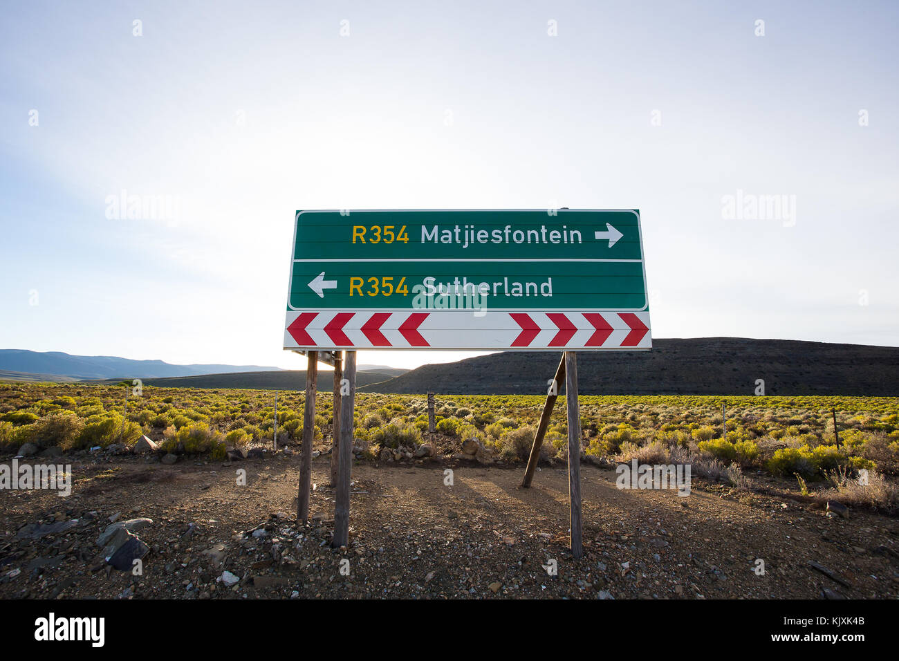 Wide Angle view of a road sign on the highway in the Tankwa Karoo, pointing out the direction to the two towns, - Stock Image
