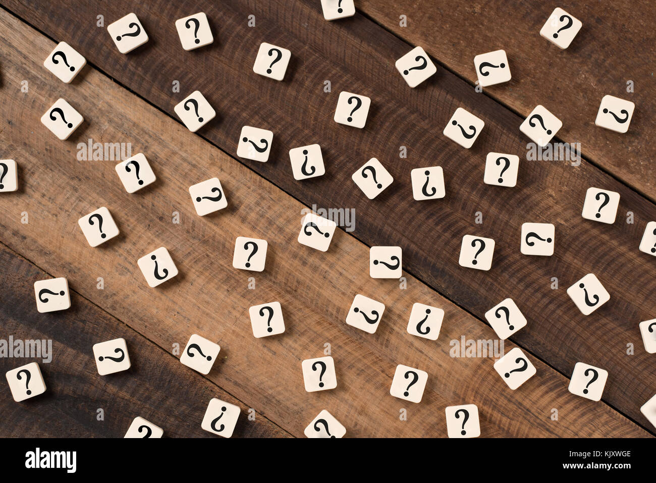 Question mark on alphabet tiles. question mark on wooden table background - Stock Image